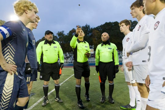 OAKLAND, NJ 10/27/2018  Game officials toss the coin prior to the Glen Rock vs. Ramsey matchup in Saturday night's Bergen County Boys High School Soccer Tournament final.  Glen Rock soared to a 3-0 victory to take the trophy.