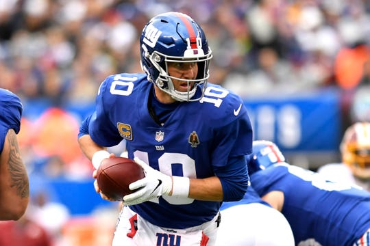 New York Giants quarterback Eli Manning (10) looks to hand the ball off to running back Saquon Barkley (not pictured). The Giants lose to the Redskins 20-13 on Sunday, Oct. 28, 2018, in East Rutherford.