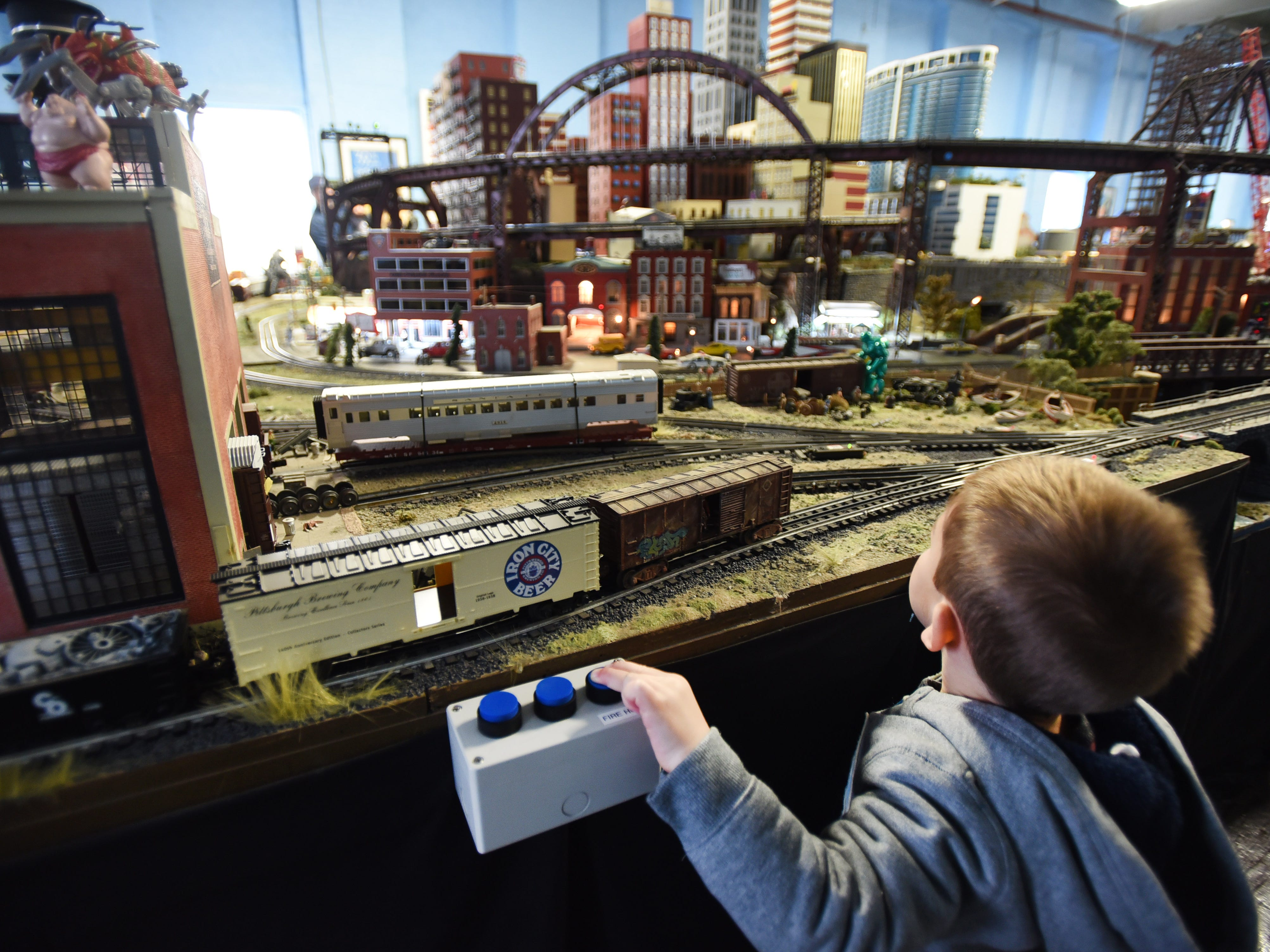 Three-year-old Alex George of Rockaway hits the power button at a model train show sponsored by the NJ Hi-Railers in Paterson on Oct. 28.