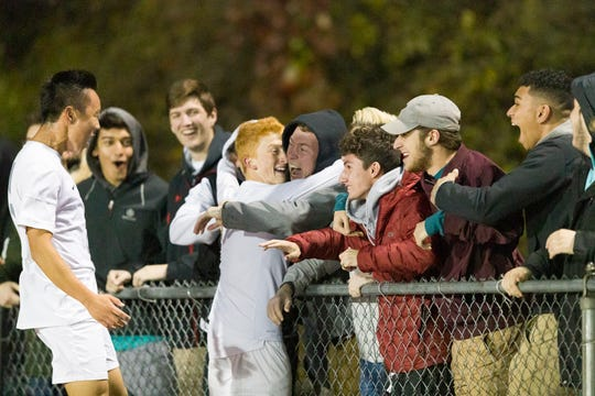 OAKLAND, NJ 10/27/2018  Glen Rock celebrates their first score against Ramsey in Saturday night's Bergen County Boys High School Soccer Tournament final.  Glen Rock soared to a commanding 3-0 victory to take the trophy.