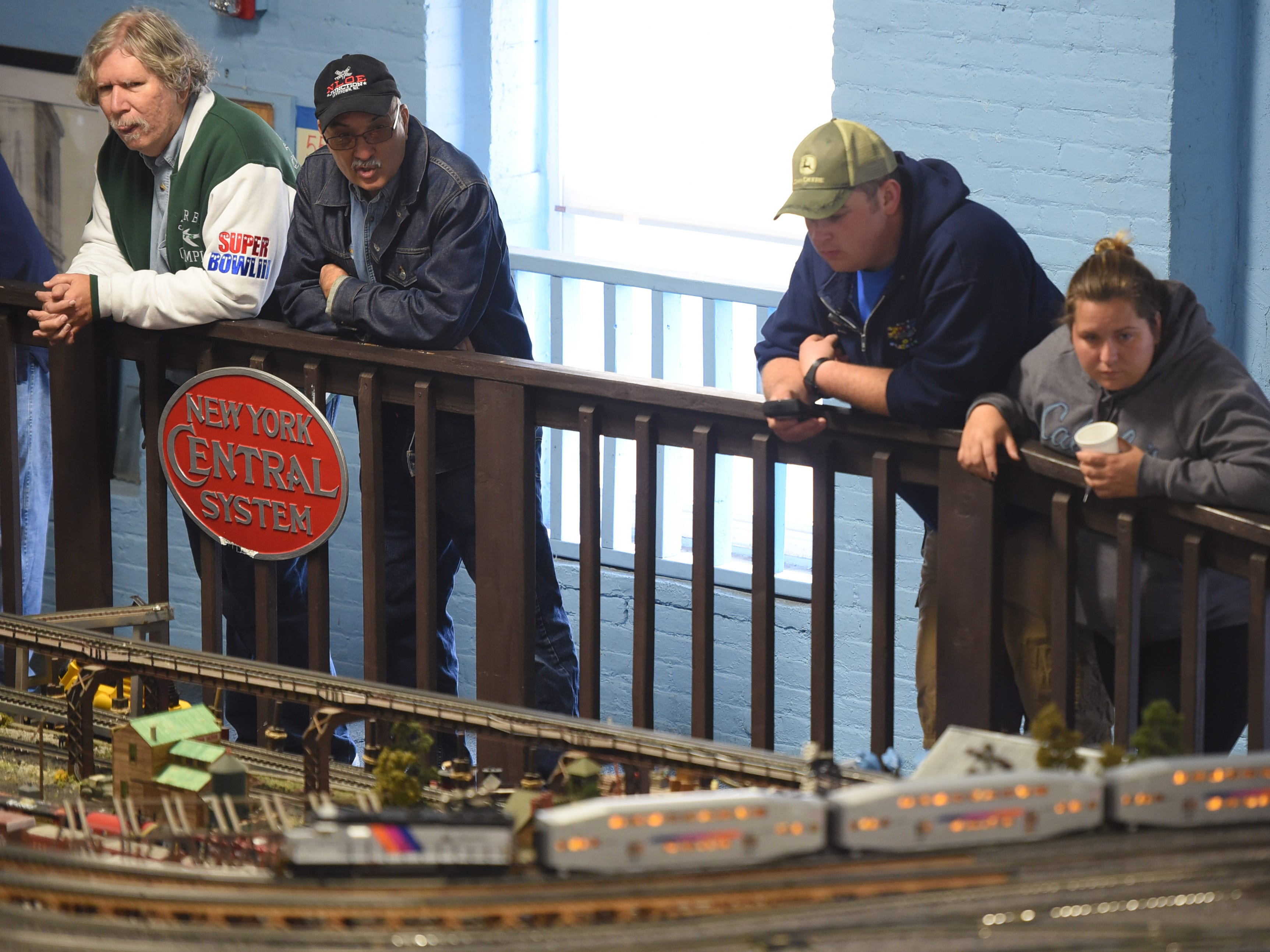 A group of visitors watch the display as the NJ Hi-Railers holds a periodic show for the public at Silk City Station in Paterson on 10/28/18.