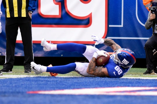 New York Giants tight end Evan Engram (88) rolls into the endzone for a touchdown in the second half. The Giants lose to the Redskins 20-13 on Sunday, Oct. 28, 2018, in East Rutherford.
