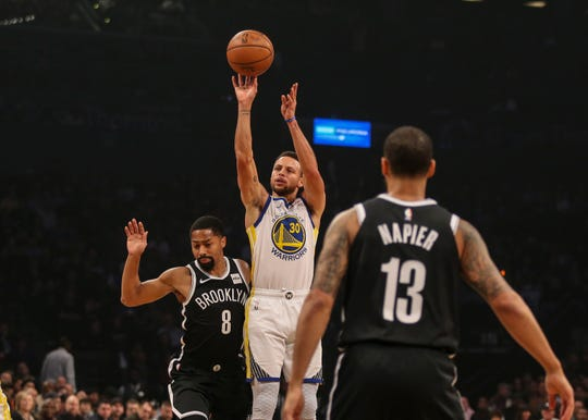 Oct 28, 2018; Brooklyn, NY, USA; Golden State Warriors guard Stephen Curry (30) takes a jump shot against the Brooklyn Nets in the first quarter at Barclays Center.