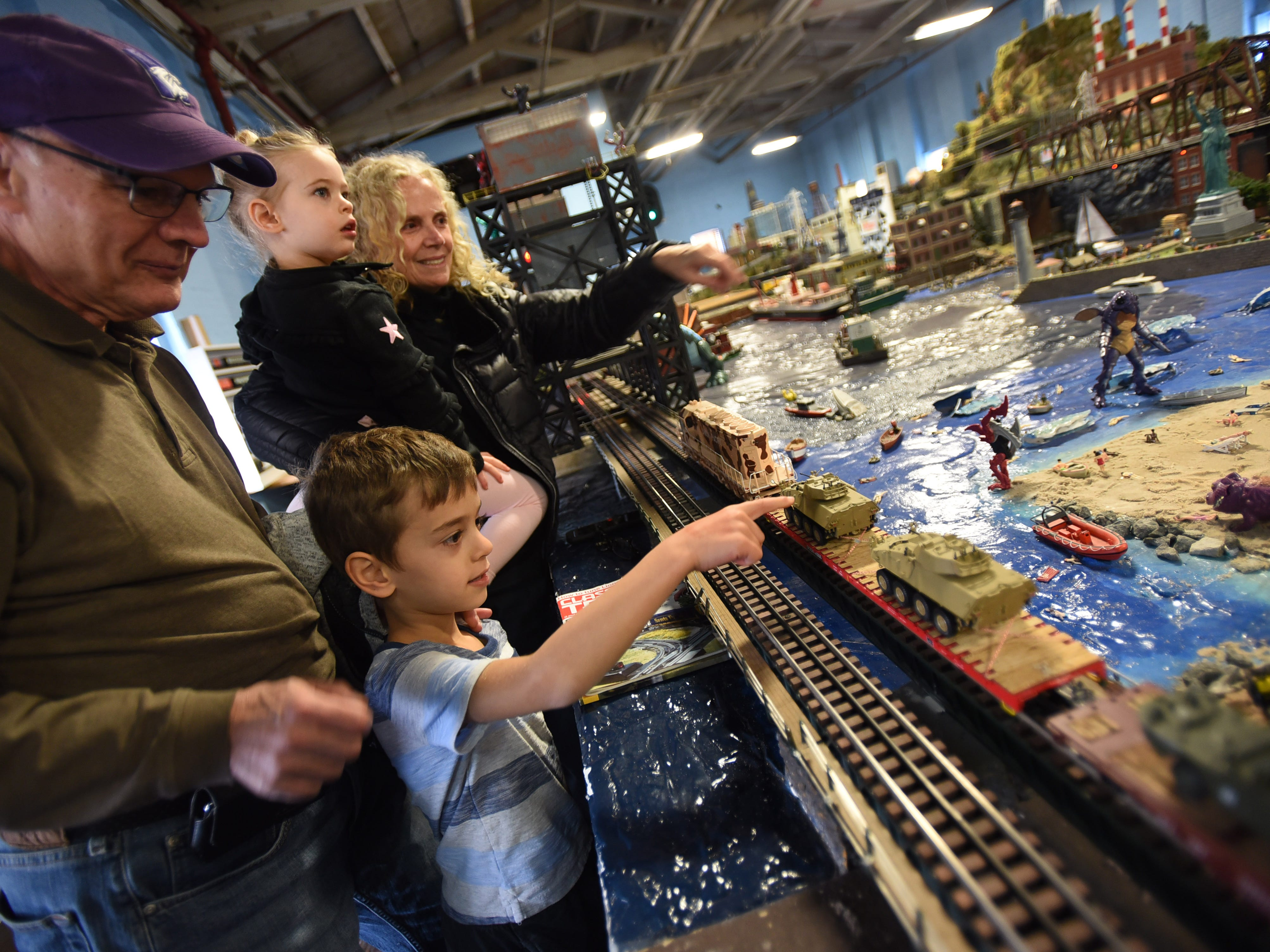 Vincent and Mary Ann Graziano of Wyckoff, accompany their grandchildren Evan (age 6) and Lia (age 3) as they enjoy watching as the NJ Hi-Railers hold periodic shows for the public at Silk City Station in Paterson on 10/28/18.