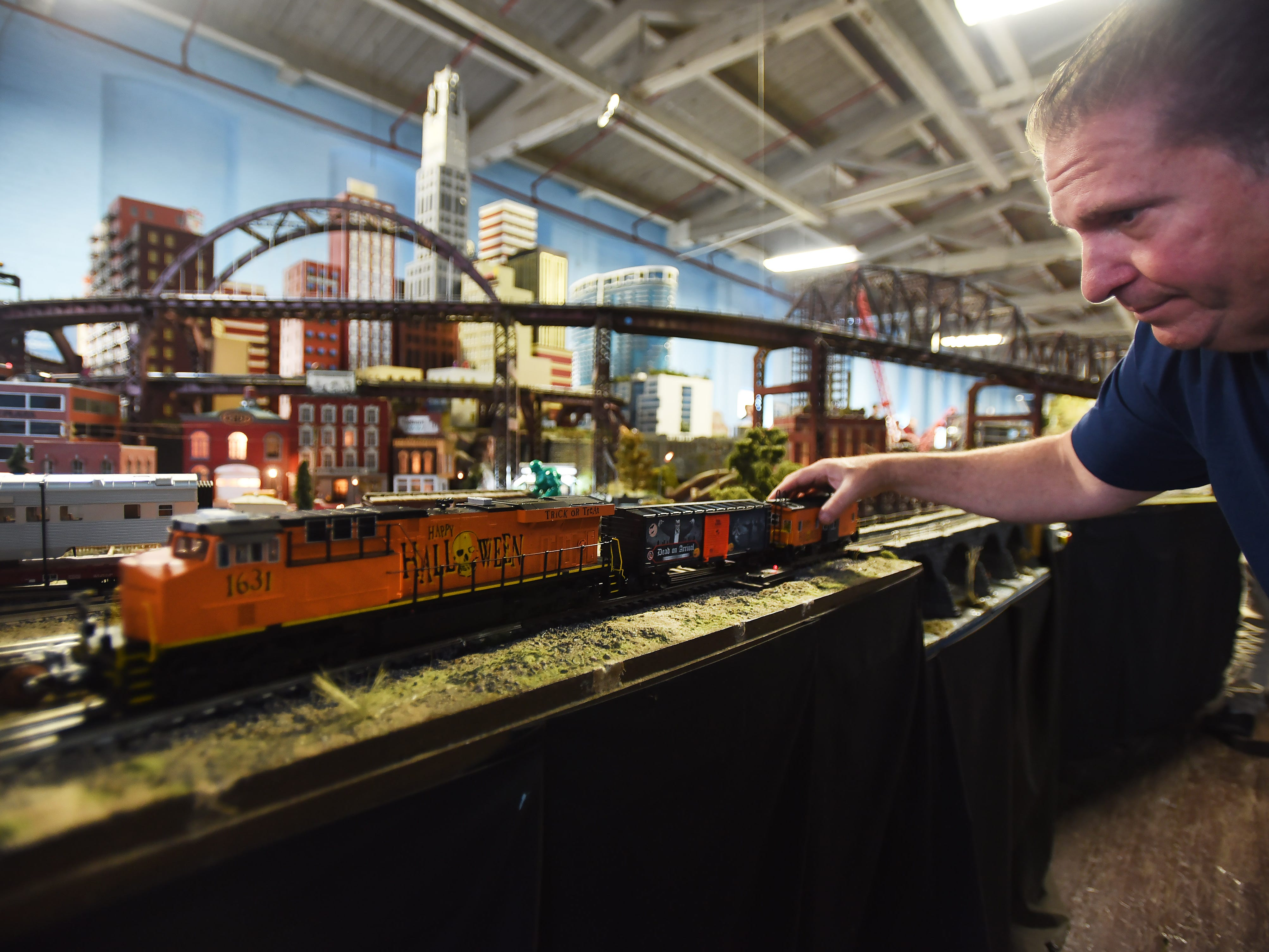 Robert Cafaro, a member of the NJ Hi-Railers Club, shows the Halloween trains during a show for the public at Silk City Station in Paterson on 10/28/18.