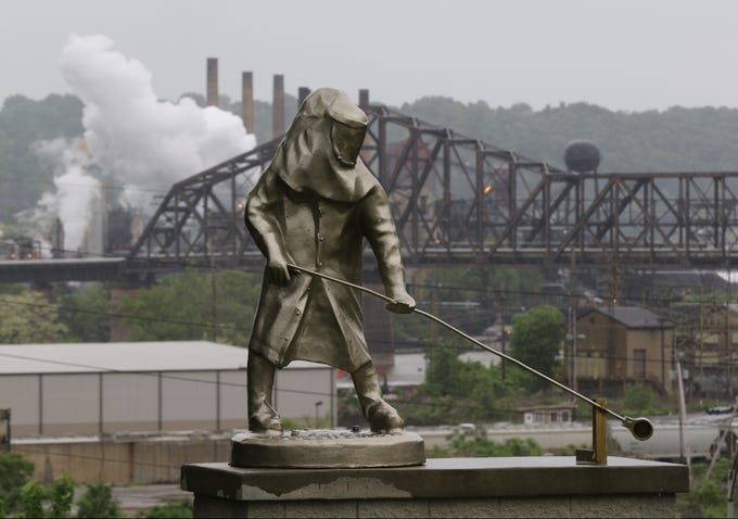 This statue in Steubenville, Ohio is dedicated to steel workers as it looks over some of the remaining steel mills that run on the Pennsylvania side of the Ohio River. The statue is across the street from the Steubenville Library.