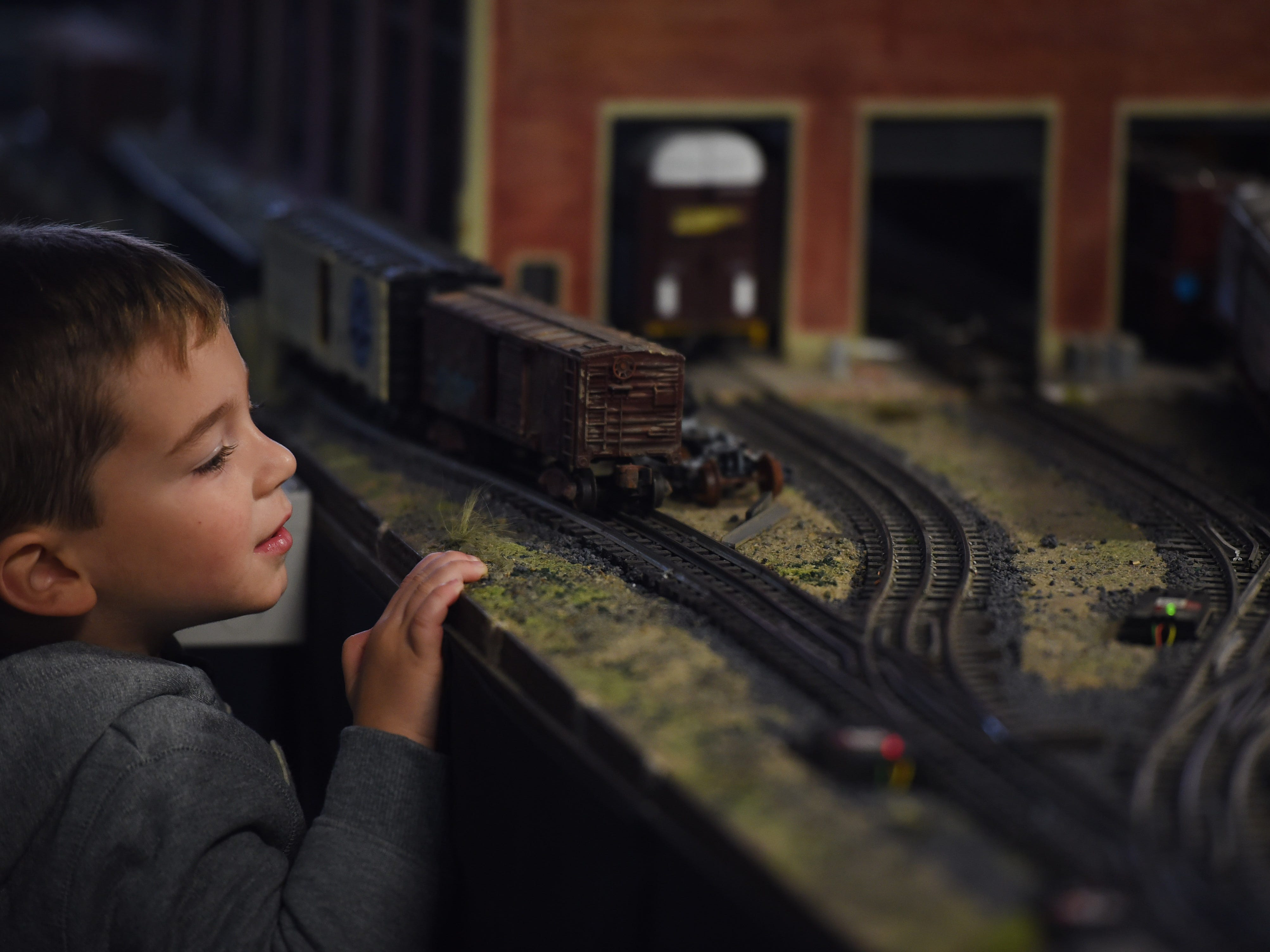 George gets a closer look at part of the model train layout.