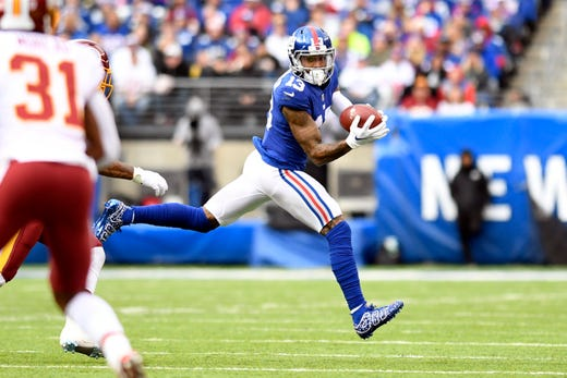 New York Giants wide receiver Odell Beckham Jr. (13) completes a pass in fbebe1b47