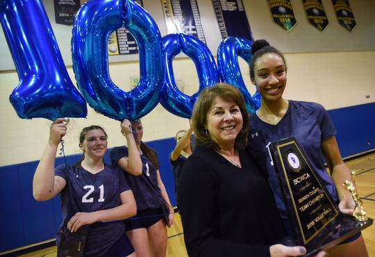 Head Coach of IHA Maria Nolan is congratulated by her players for a 1000 career win following their championship win against Old Tappan during the 44th Bergen County girls volleyball tournament at NV/Old Tappan High School on 10/28/18. IHA won the championship 25 - 19, 25 -23.