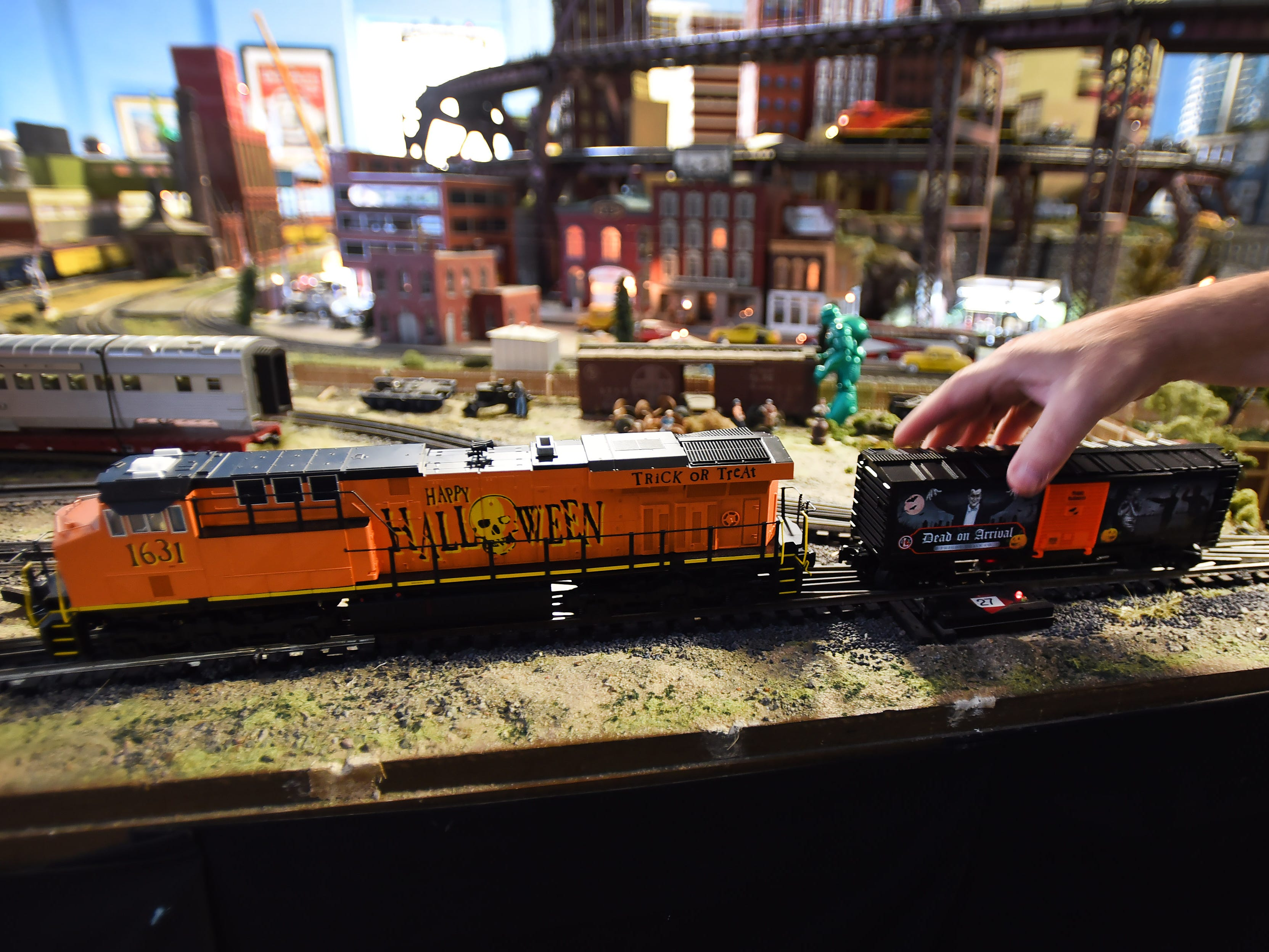 Robert Cafaro (not shown), a member of the NJ Hi-Railers Club, shows the Halloween trains during a show for the public at Silk City Station in Paterson on 10/28/18.