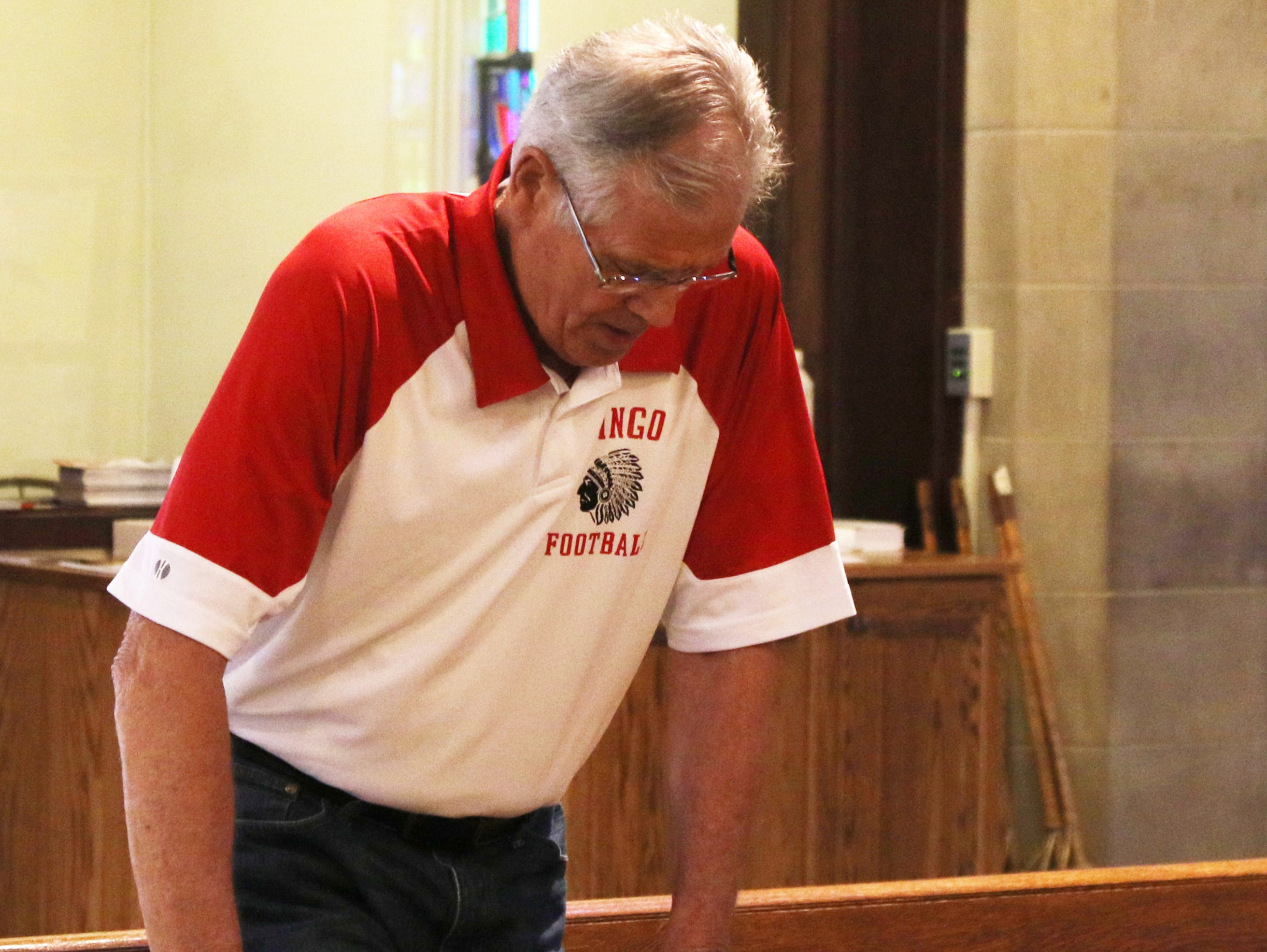Mike Herrick is the former football coach from MIngo High School that closed in 1993. Herrick is seen hearing praying as he attends mass almost every morning at St. Agnes Church in Mingo Junction.