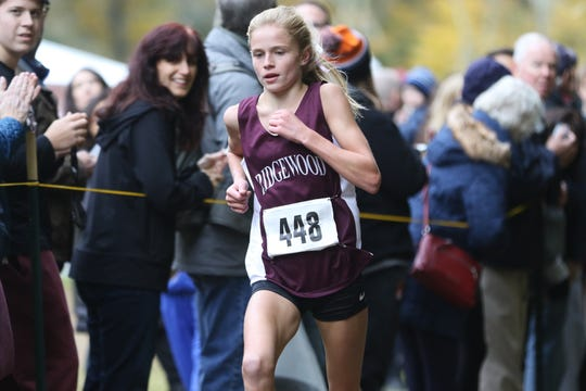 Camryn Wennersten, of Ridgewood is shown as she approaches the finish line with a time of 18:10.  Wennersten came in second place and Ridgewood won the team title at the Bergen County Cross Country Championship.  Sunday, October 28, 2018