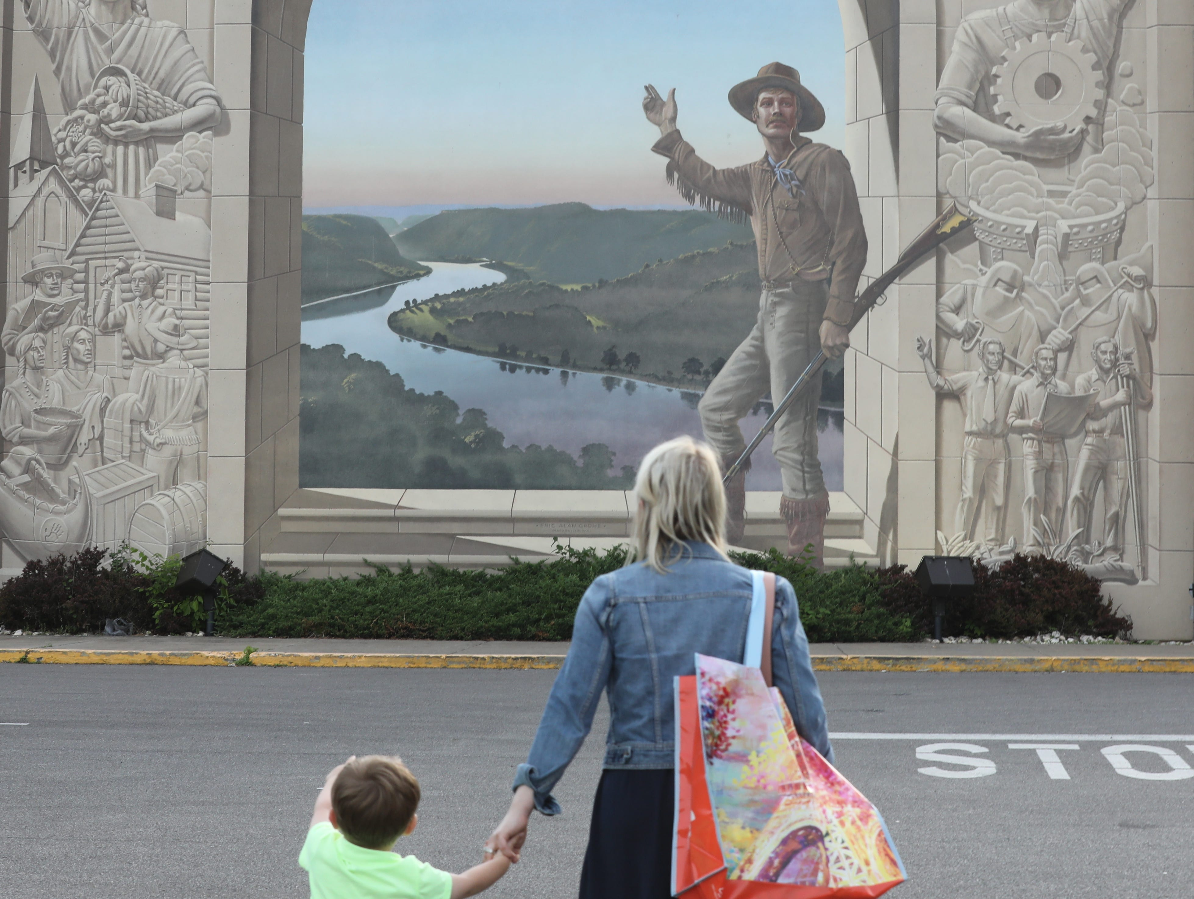 One of the many murals in Steubenville, Ohio. This is Pioneer Days showing the Gateway Arch out west on the Ohio River. It also is a dedication to steel and other Ohio River Valley industries. The mural is in an outdoor shopping mall next door to a restaurant.