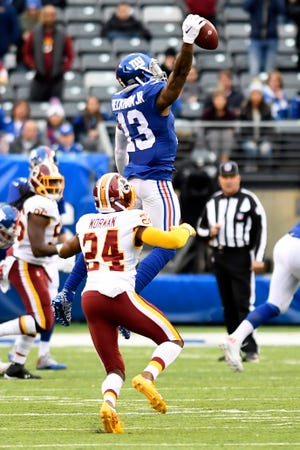 New York Giants wide receiver Odell Beckham Jr. (13) makes a one-handed catch over Washington Redskins cornerback Josh Norman (24) in the second half. The Giants lose to the Redskins 20-13 on Sunday, Oct. 28, 2018, in East Rutherford.