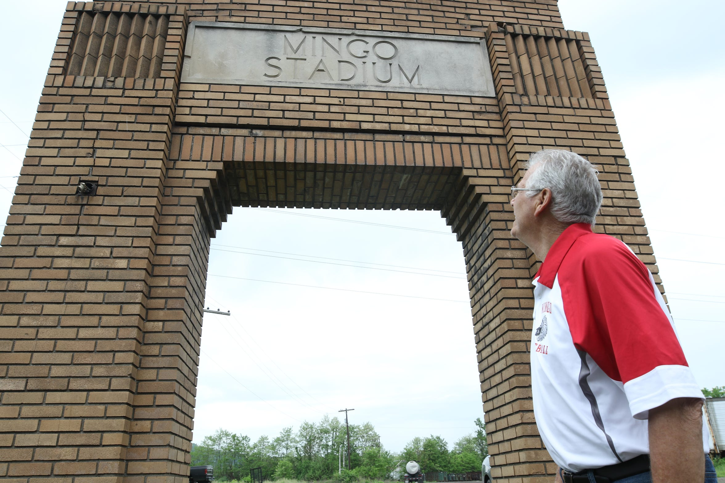 "Michael Herrick, 74, coached the Mingo Junction High School football team until the school closed in 1993. ""Oh, what a town this once was,' Herrick said. ""This used to be the most beautiful small town you ever wanted."""