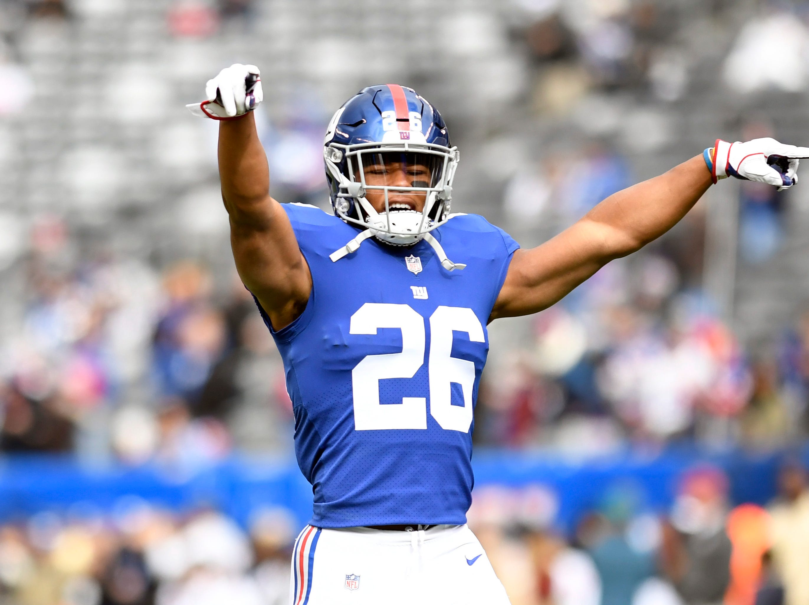 New York Giants running back Saquon Barkley (26) dances during warmups in Week 8 on Sunday, Oct. 28, 2018, in East Rutherford.