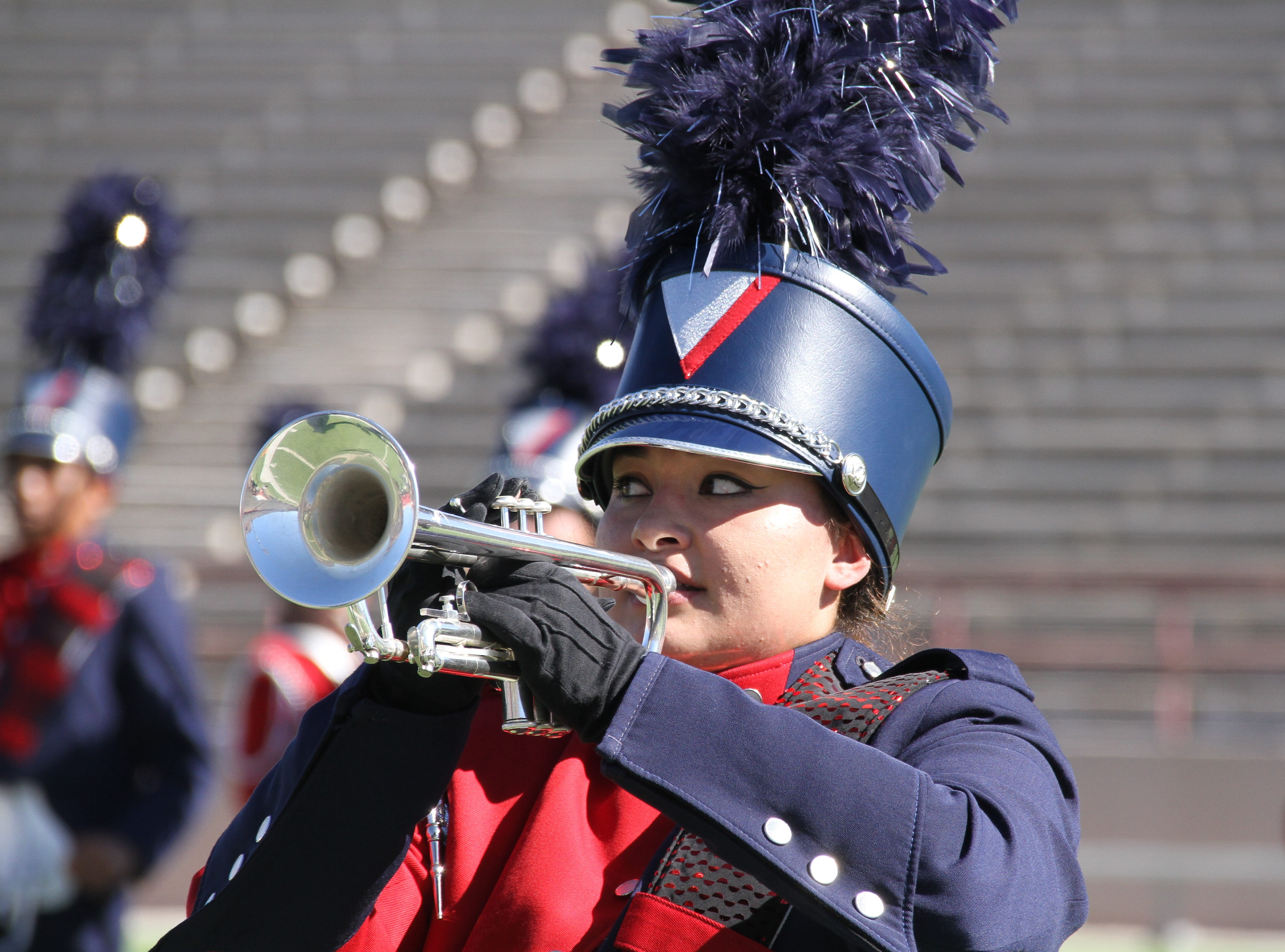 Kyleen Hensley keeps in step with her horn.