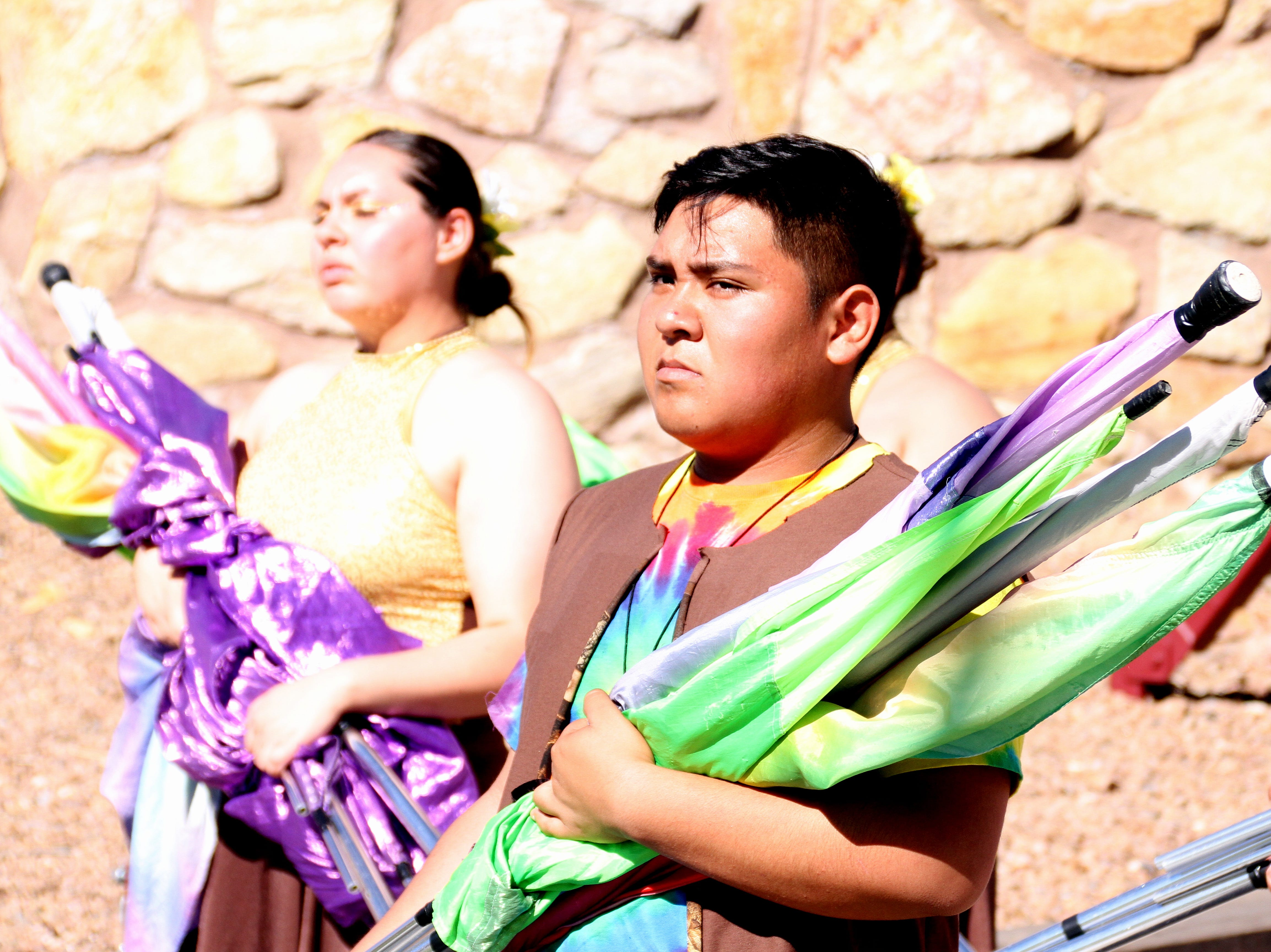 The color guard adds to the performance aspect of the DHS Wildcat Marching Band.