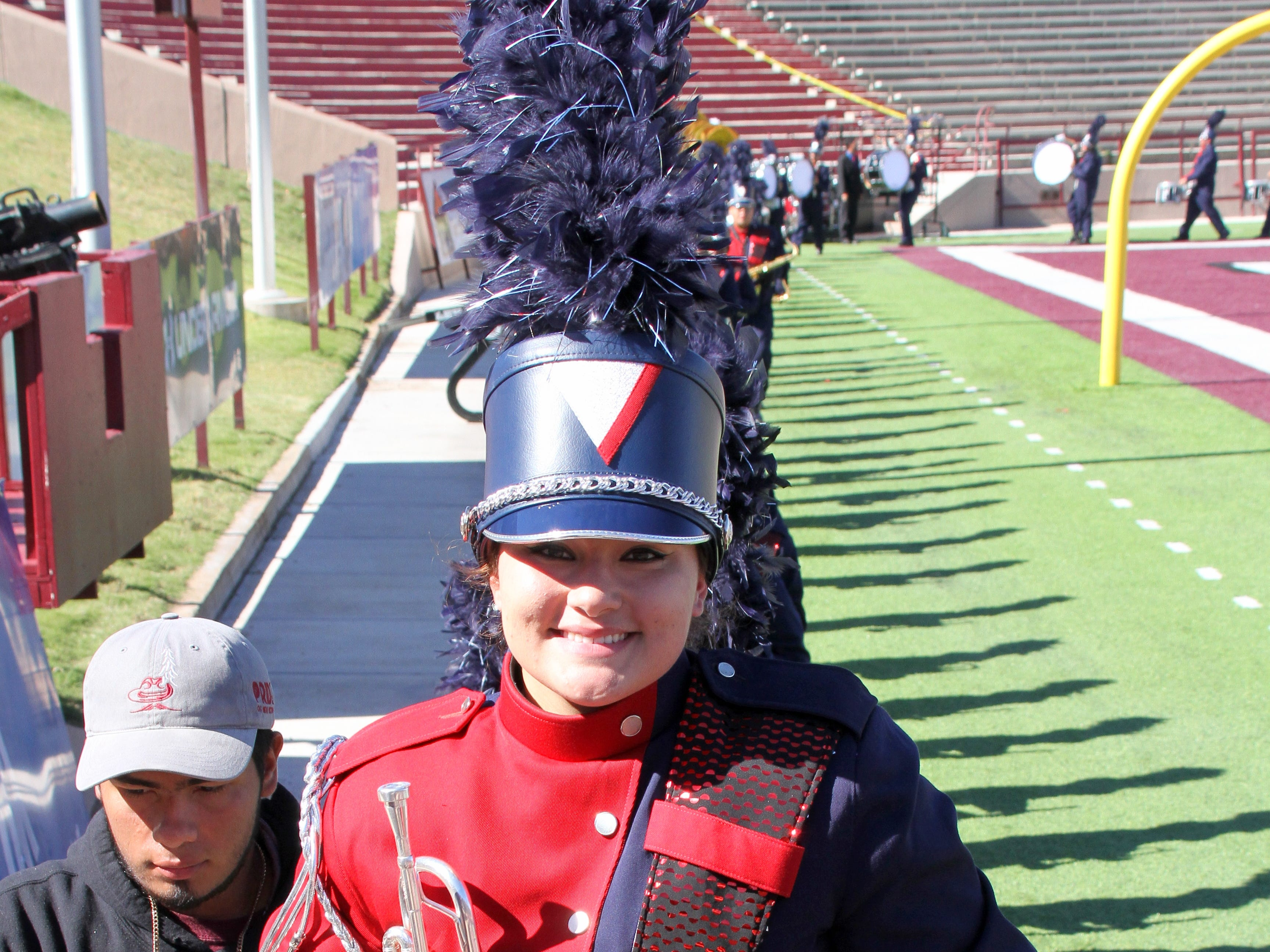 Kyleen Hensley is all smiles following the Deming High Wildcat Marching Band performance at the 41st annual Tournament of Bands at Aggie Memorial Stadium on the campus of New Mexico State University in Las Cruces, NM.