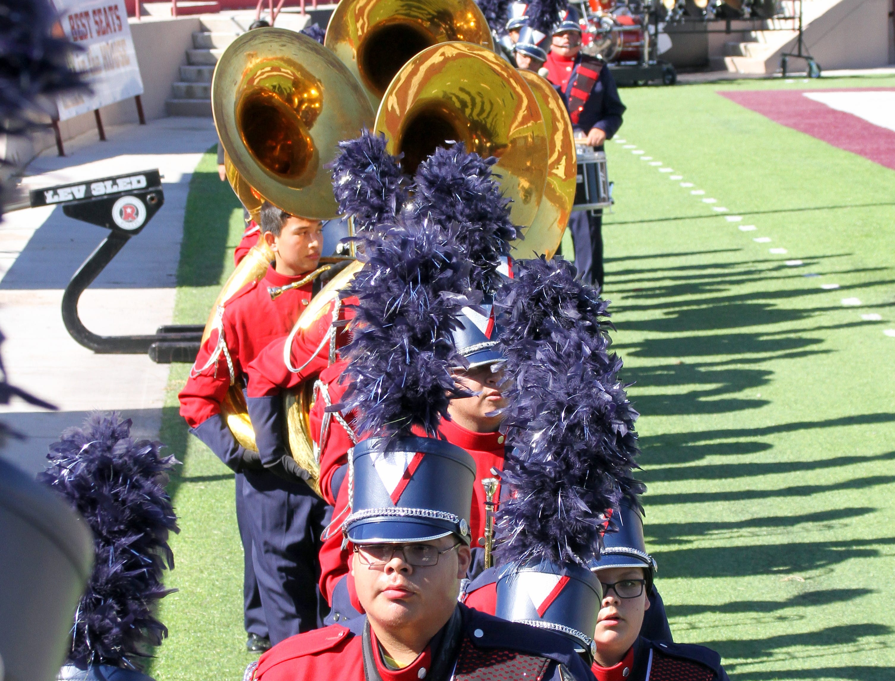 The Pride of Deming High leaves the field at Aggie Memorial Stadium.