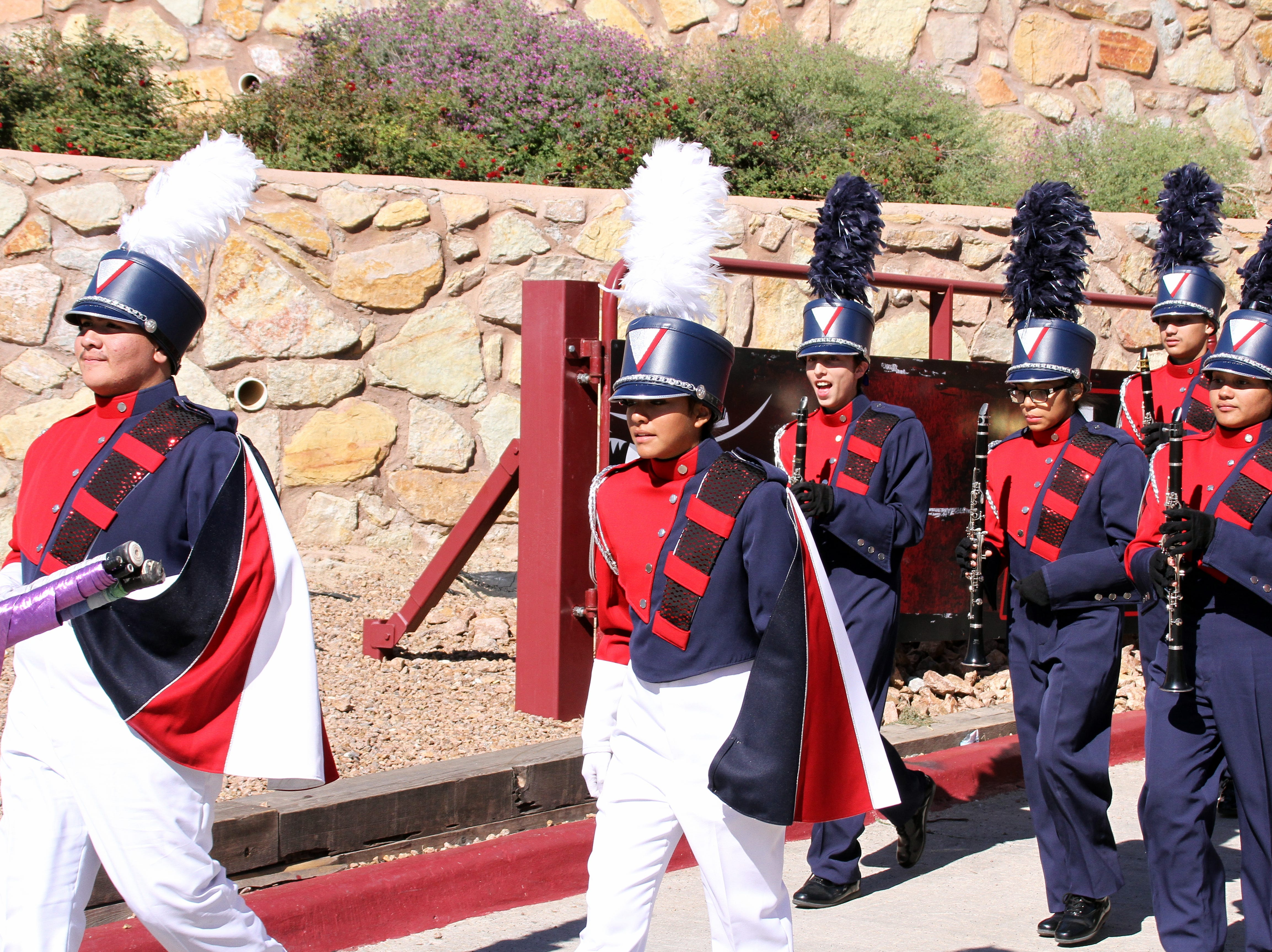 Drum Majors lead the Wildcat Marching Band onto the field at Aggie Memorial Stadium.