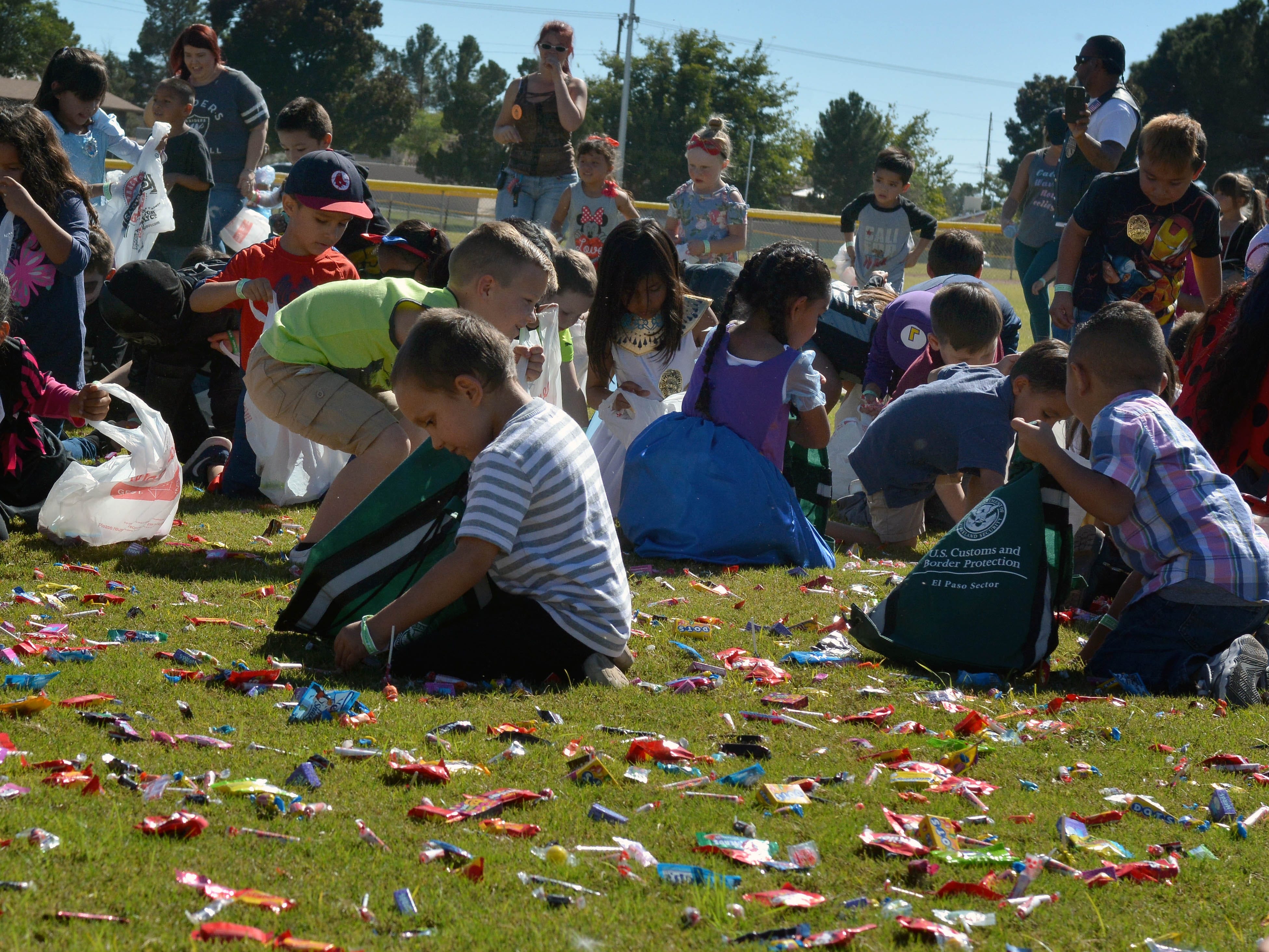 Children fill their bags with candy during the 14th annual Great Pumpkin Candy Drop, held Sunday, Oct, 28 at Maag Park.