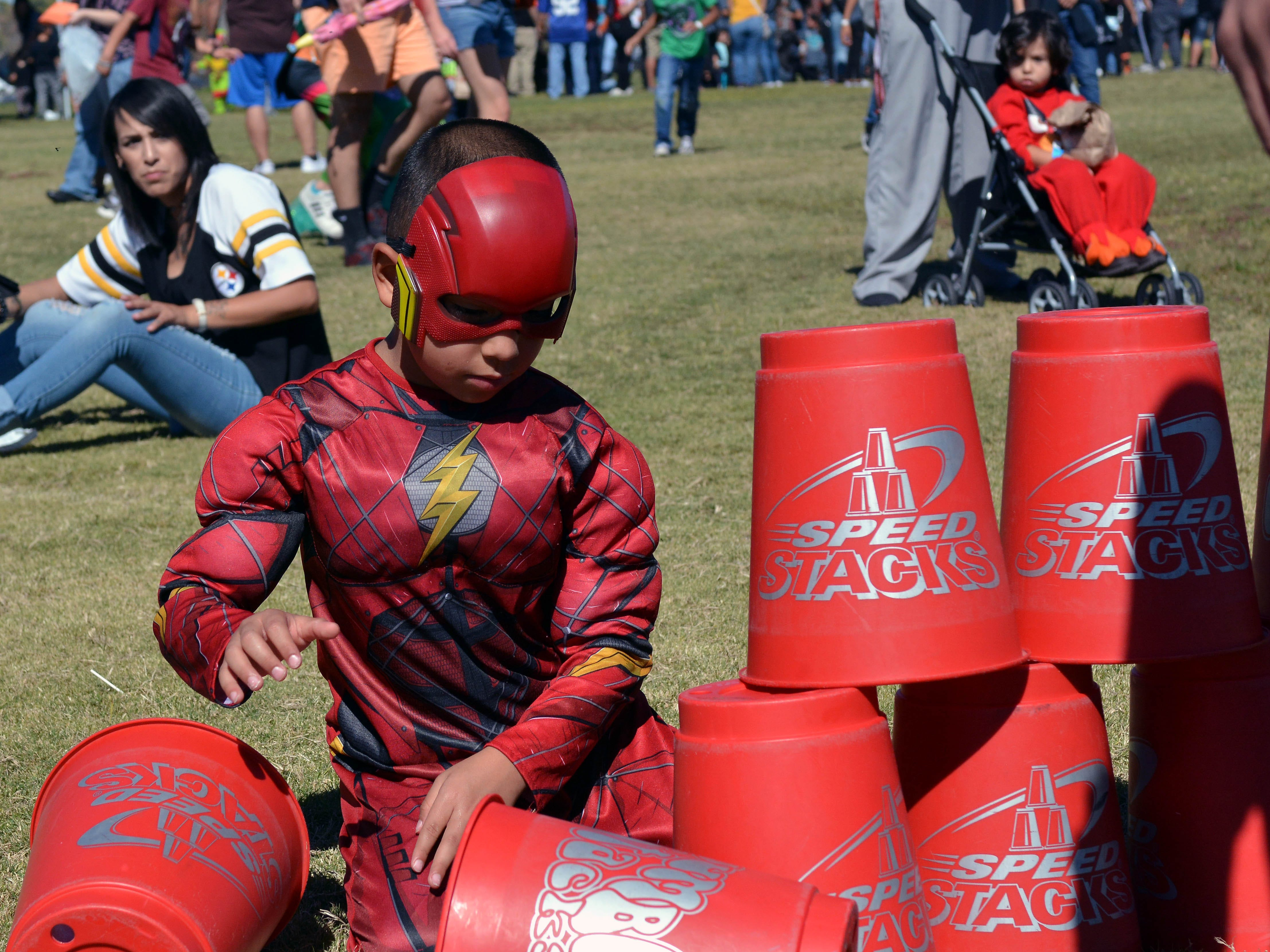 "Anthony ""The Flash"" Brown, 6, tries his hand at Speed Stacks during the 14th annual Great Pumpkin Candy Drop, held Sunday, Oct, 28 at Maag Park."