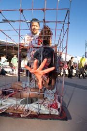 Ralph Reyes pushes Briana Reyes, 13, in a cage during the 2018 Zombie Walk on Saturday, Oct. 27, 2018 in downtown Las Cruces. The father-daughter combo won best team costume.