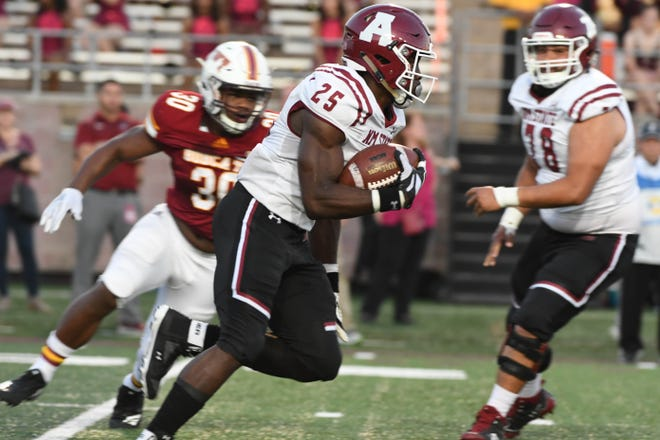New Mexico State running back Christian Gibson runs the ball against Texas State on Saturday in San Marcos, Texas.