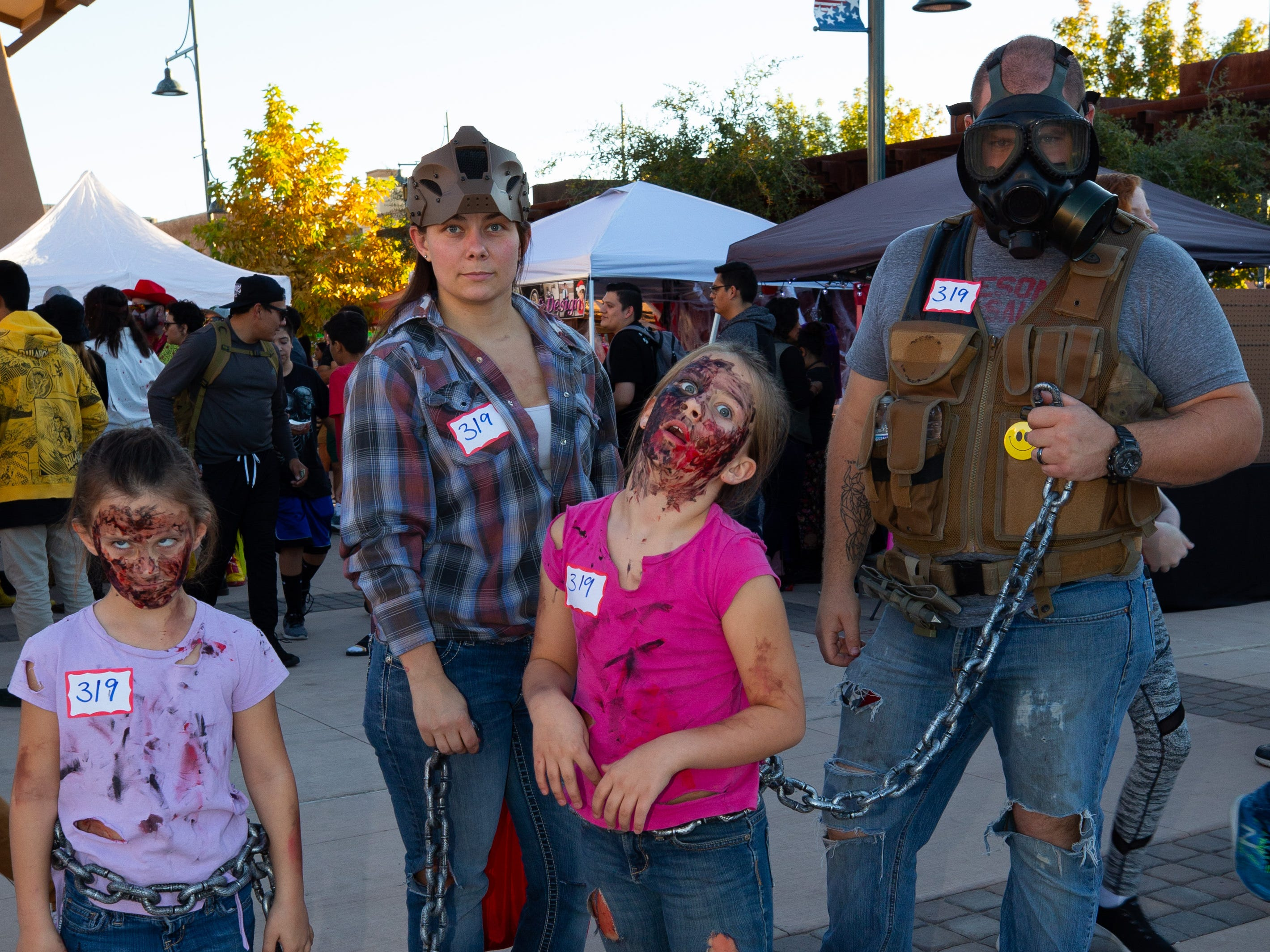 """""""The Walking Dead"""" family, from left: Brooklynn Knight, 6; Jae Knight; Mattilynn Knight, 8; and Brady Knight at the 2018 Zombie Walk held on Saturday, Oct. 27, 2018."""