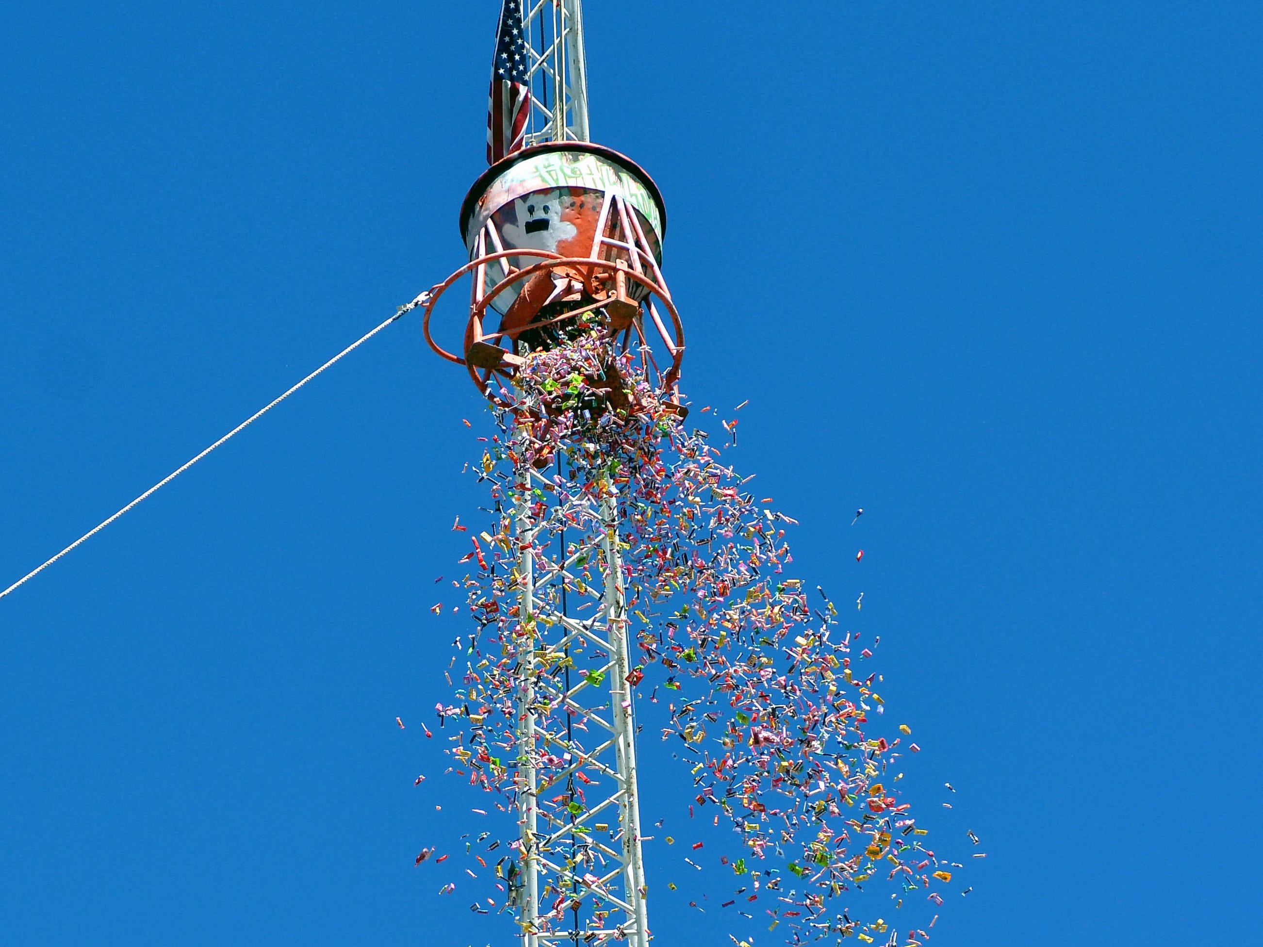 Cranes provided by Weaver's Welding and Crane Service drop candy from 70 feet up in the air during the 14th annual Great Pumpkin Candy Drop, held Sunday, Oct, 28 at Maag Park.