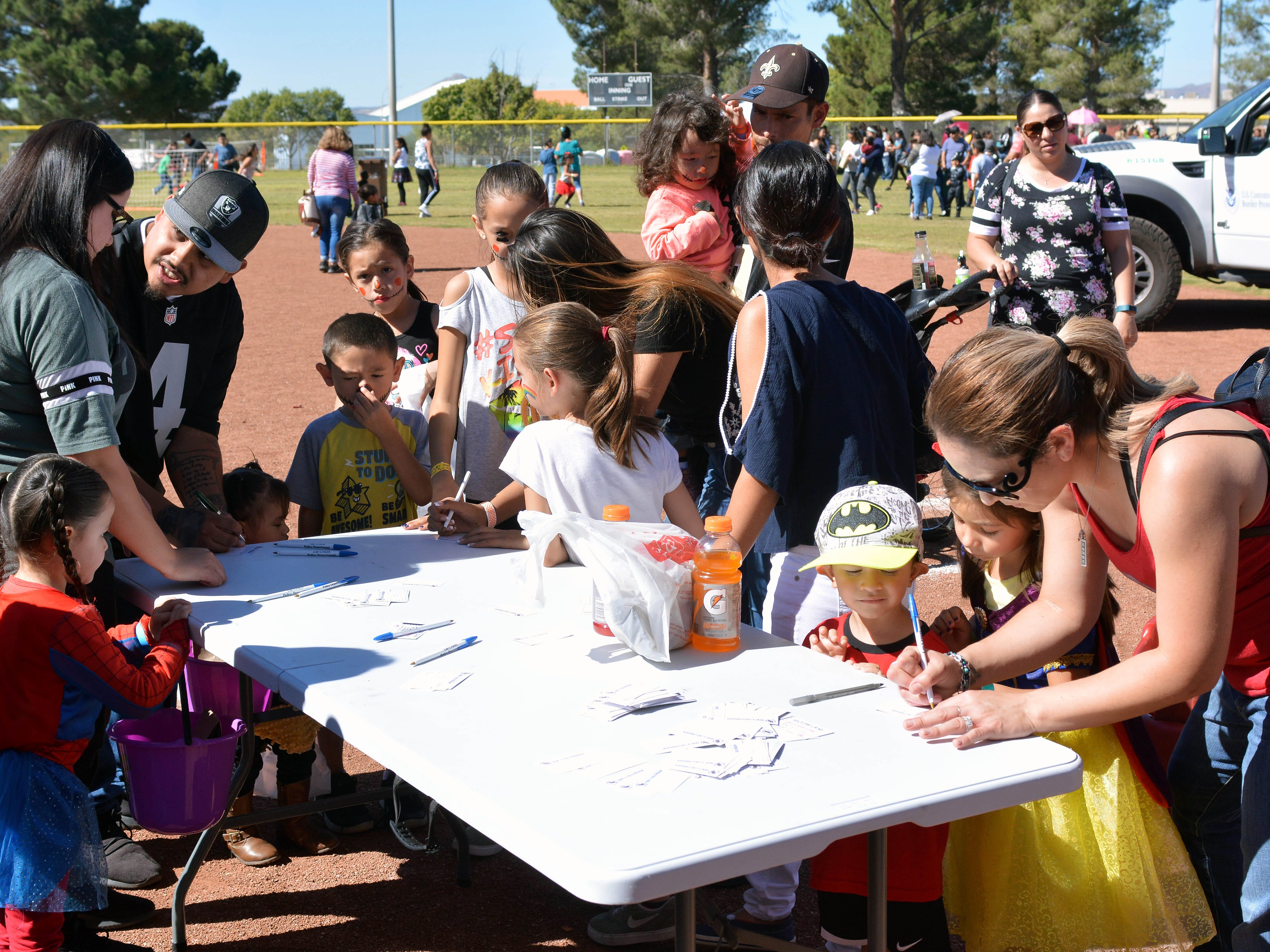 Parents register children by age group for this year's 14th annual Great Pumpkin Candy Drop, held Sunday, Oct, 28 at Maag Park.