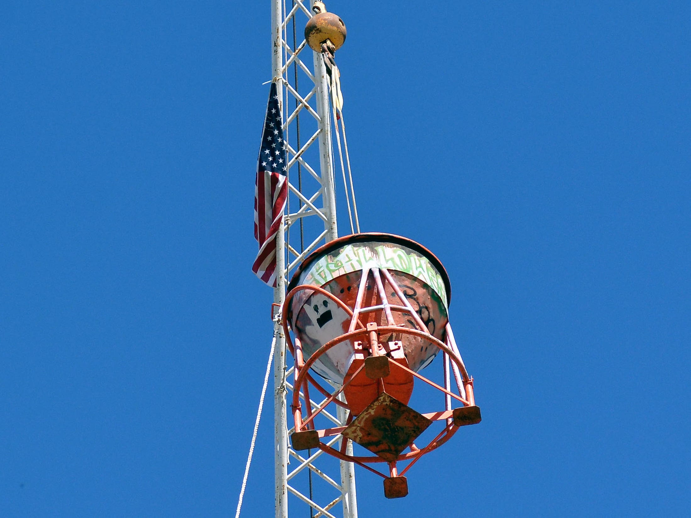 Cranes hoist tanks filled with treat ready to drop from 70 feet up in the air during the 14th annual Great Pumpkin Candy Drop, held Sunday, Oct, 28 at Maag Park.