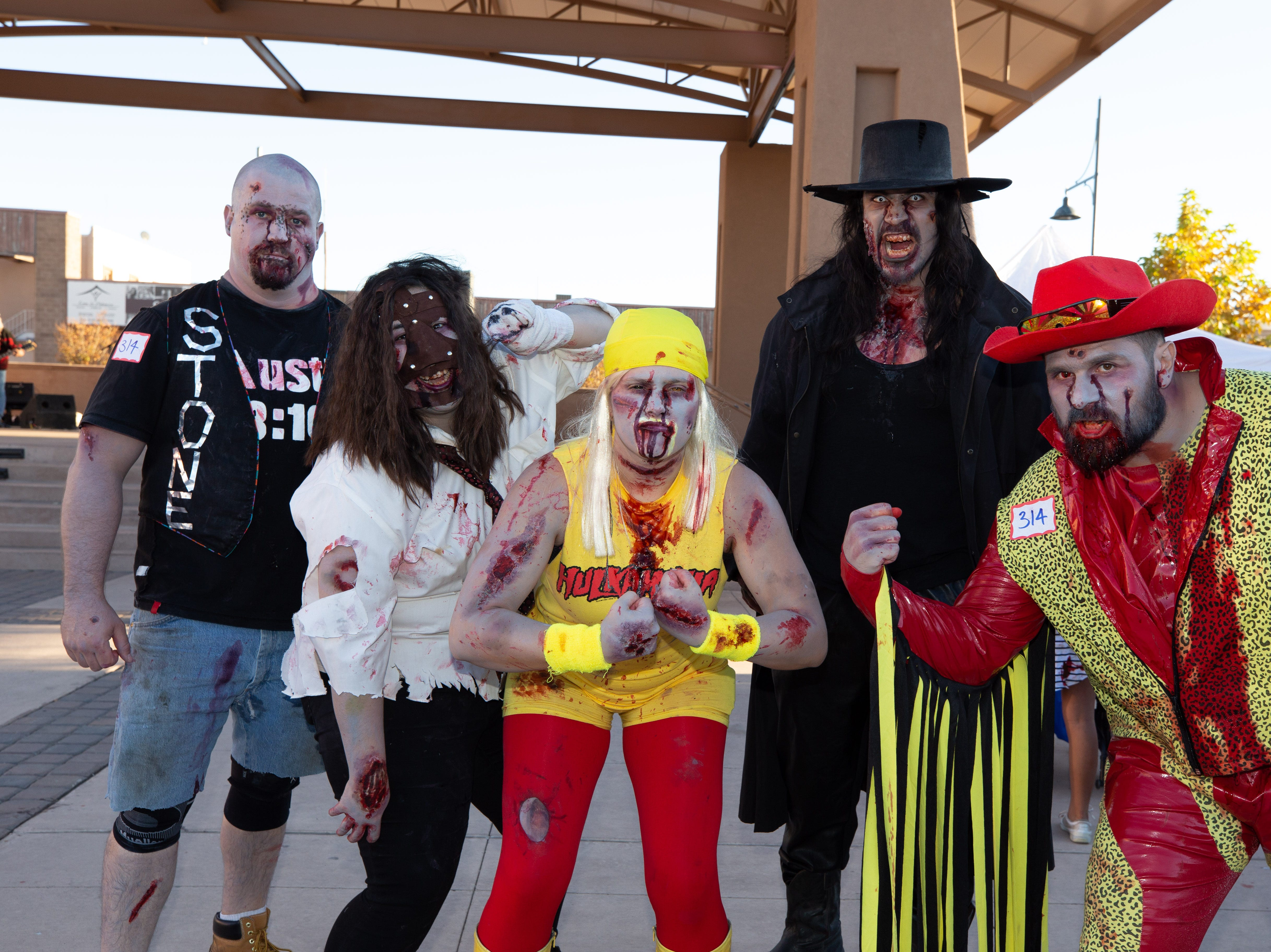 WWE superstars at the 2018 Zombie Walk. A group of friends — Chase Paul, Cheyenne Paul, Danielle Sutton, Michael Sutton and Nick Sanchez — portray, from left, Stone Cold Steve Austin, Mankind, Hulk Hogan, Undertaker and Macho Man. The 2018 Zombie Walk was held on Saturday, Oct. 27, 2018.
