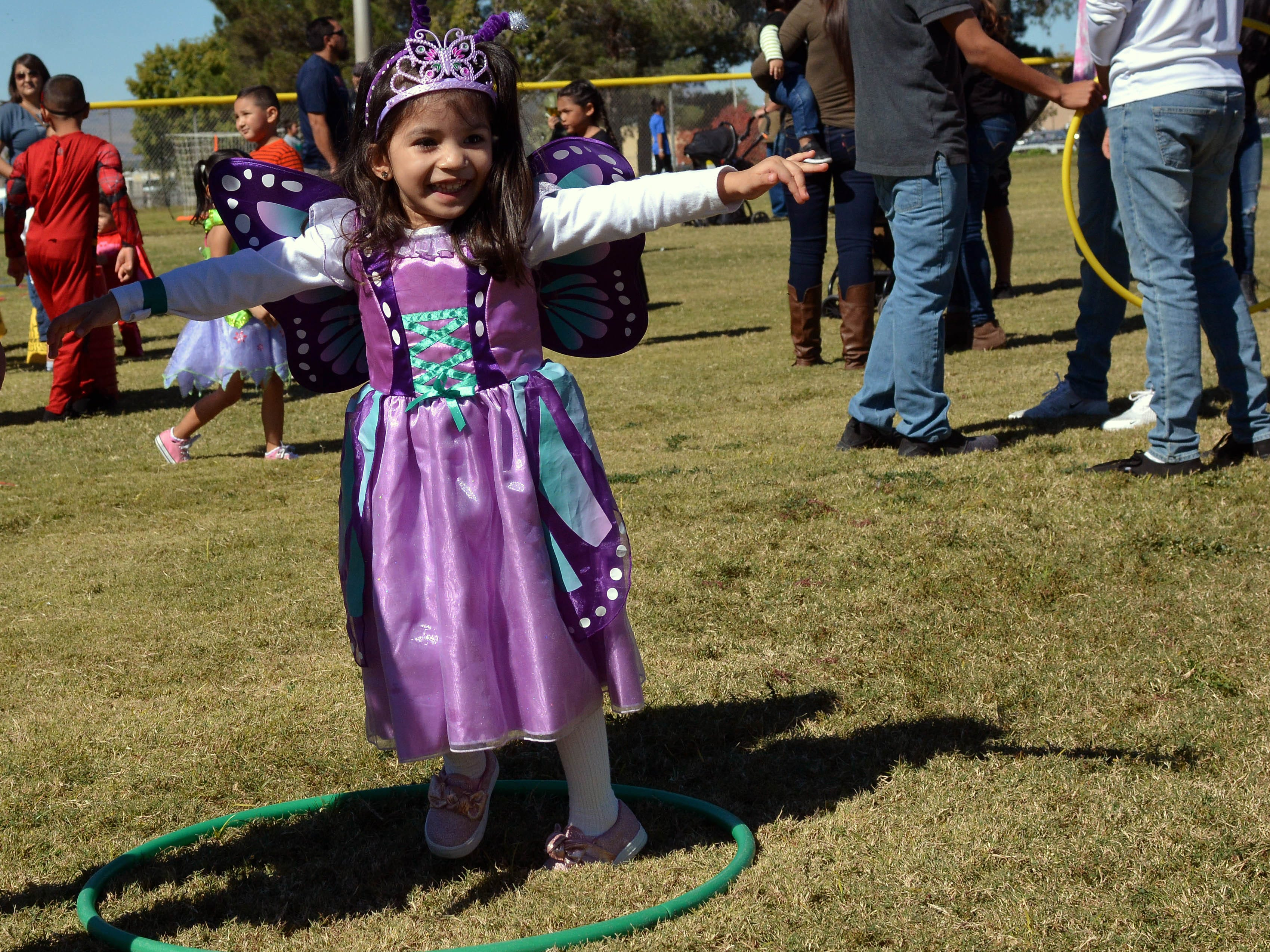 Zia Davila, 3, has fun trying her skills with the hula hoop during the 14th annual Great Pumpkin Candy Drop, held Sunday, Oct, 28 at Maag Park.