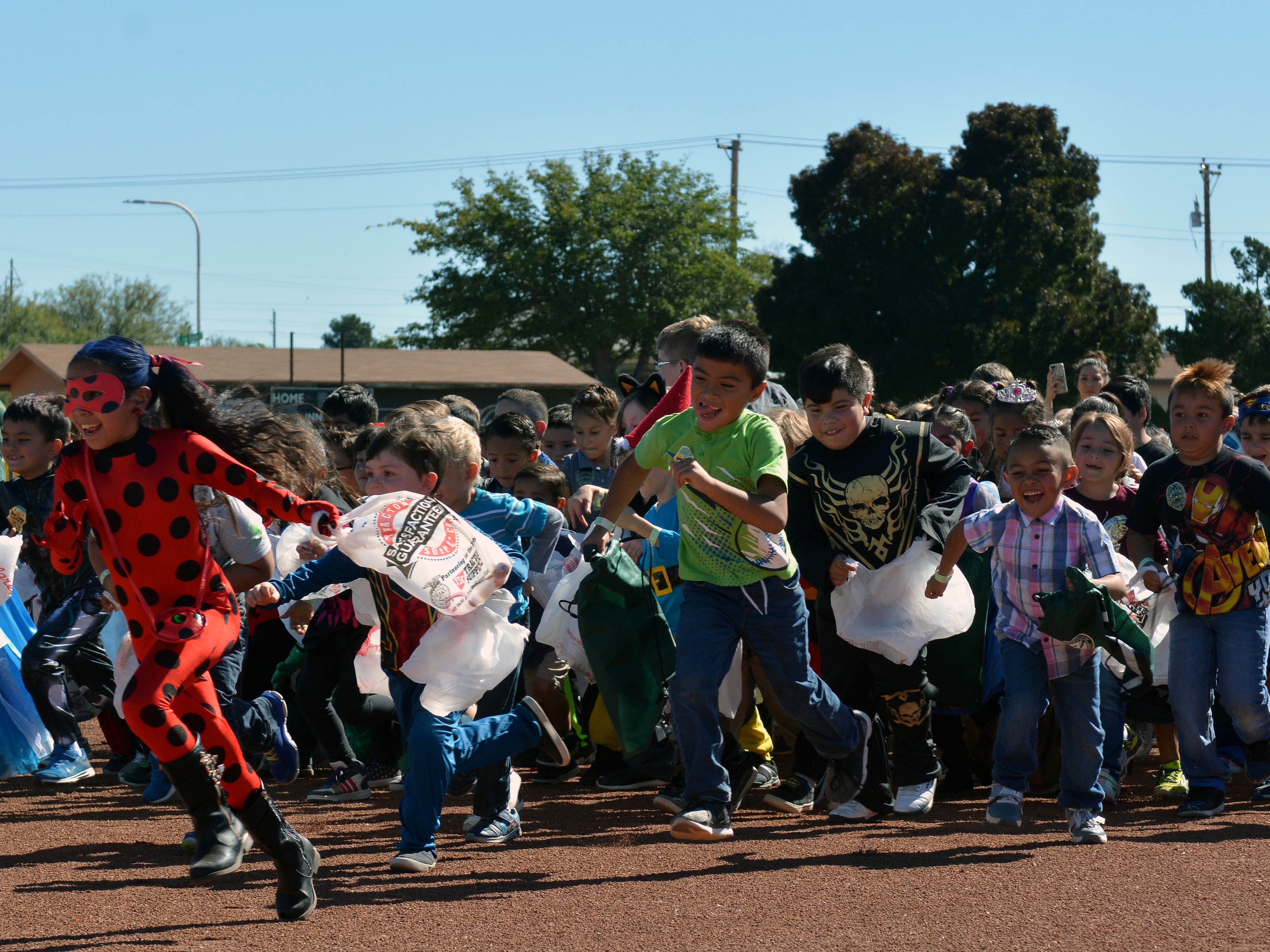 The first group of children makes a dash to the candy dropped during the 14th annual Great Pumpkin Candy Drop, held Sunday, Oct, 28 at Maag Park.