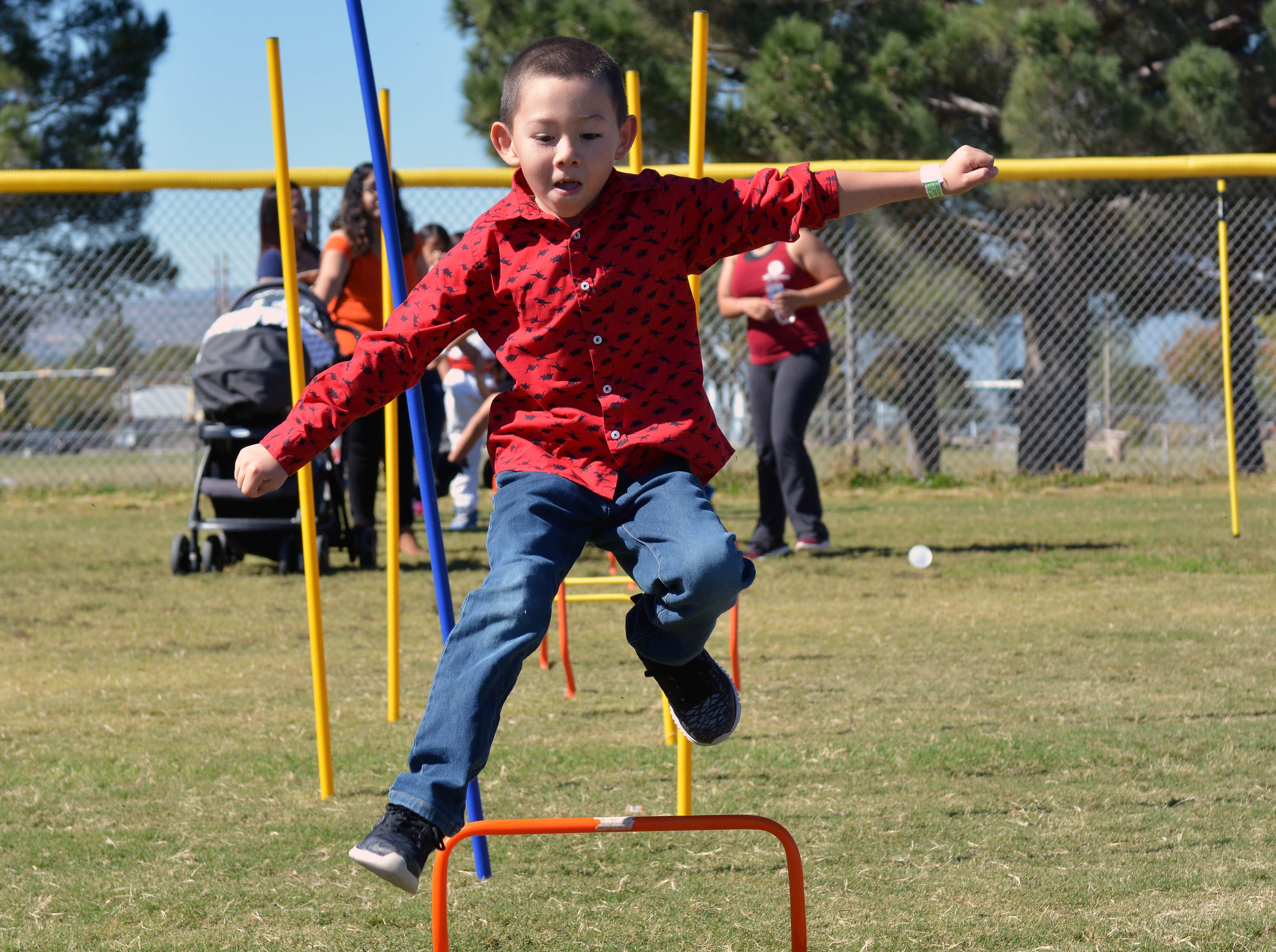 Jaden Palafox, 6, runs the obstacle course at this year's 14th annual Great Pumpkin Candy Drop, held Sunday, Oct, 28 at Maag Park.