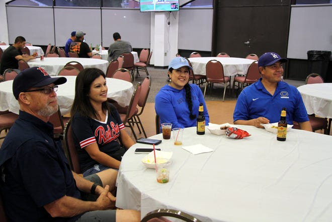 Boston and LA fans enjoy the game together during Saturday's World Series Viewing Party.