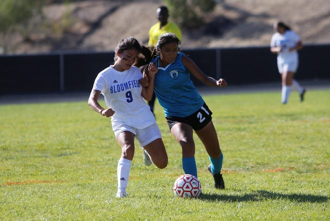 Bloomfield's Natalia Eveland and Navajo Prep's Kaieya Boyd battle for possession of the ball during a non-district match on Tuesday, Sept. 18 at Eagle Stadium. Prep will host its first-ever state playoff match against Rehoboth Christian.