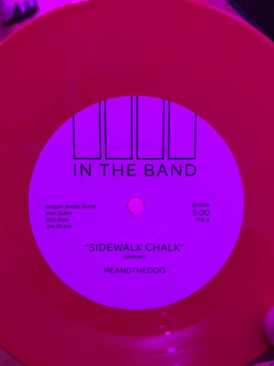 A new 7-inch vinyl single, featuring two In The Band performers, was distributed to fans Saturday night.