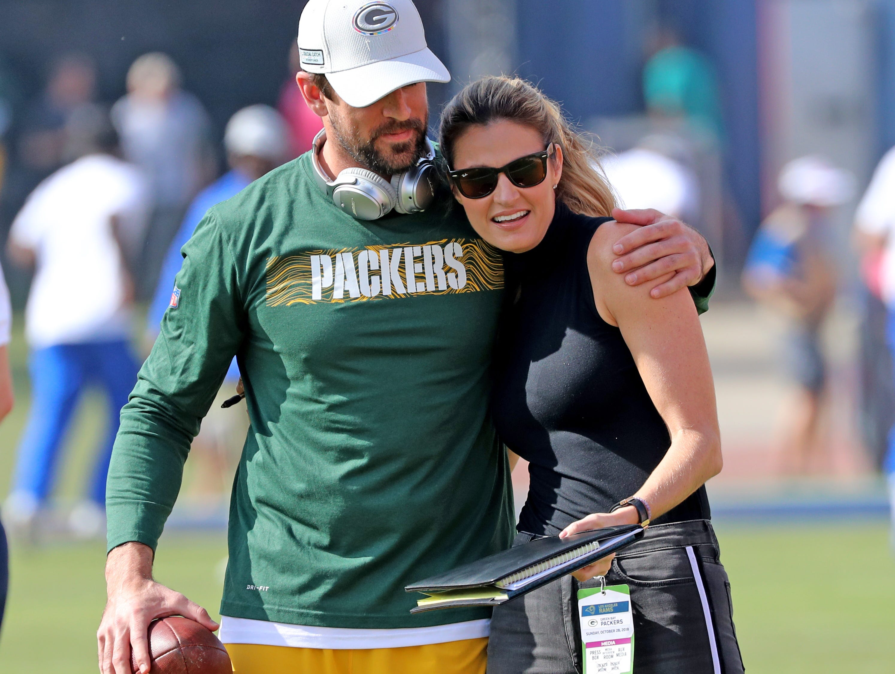 Green Bay Packers quarterback Aaron Rodgers (12) gets a hug from Erin Andrews during warmups before the game against the LA Rams Sunday, October 28, 2018 at the Memorial Coliseum in Los Angeles.