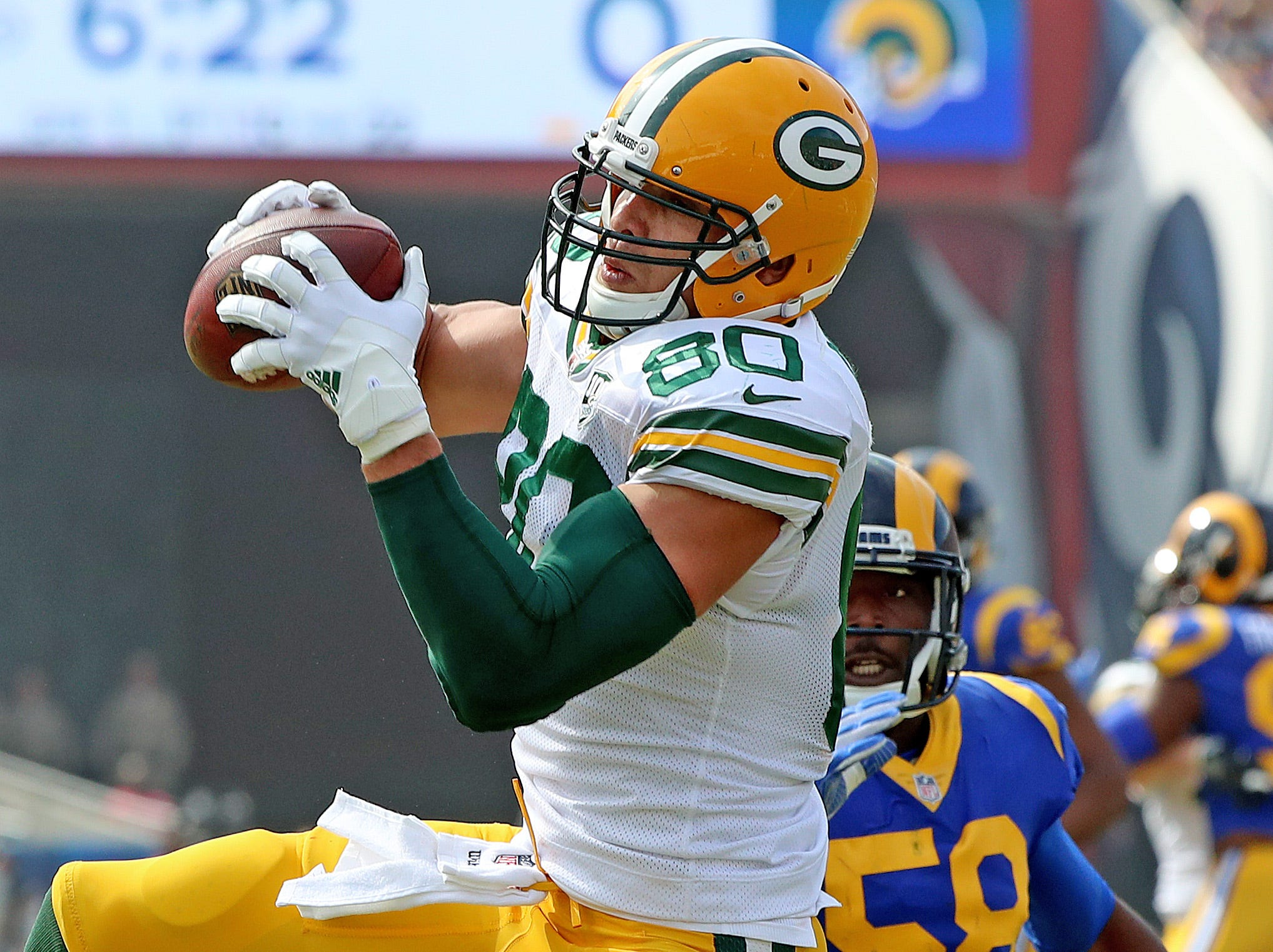 Green Bay Packers tight end Jimmy Graham (80) makes a catch against the LA Rams linebacker Cory Littleton (58) Sunday, October 28, 2018 at the Memorial Coliseum in Los Angeles.