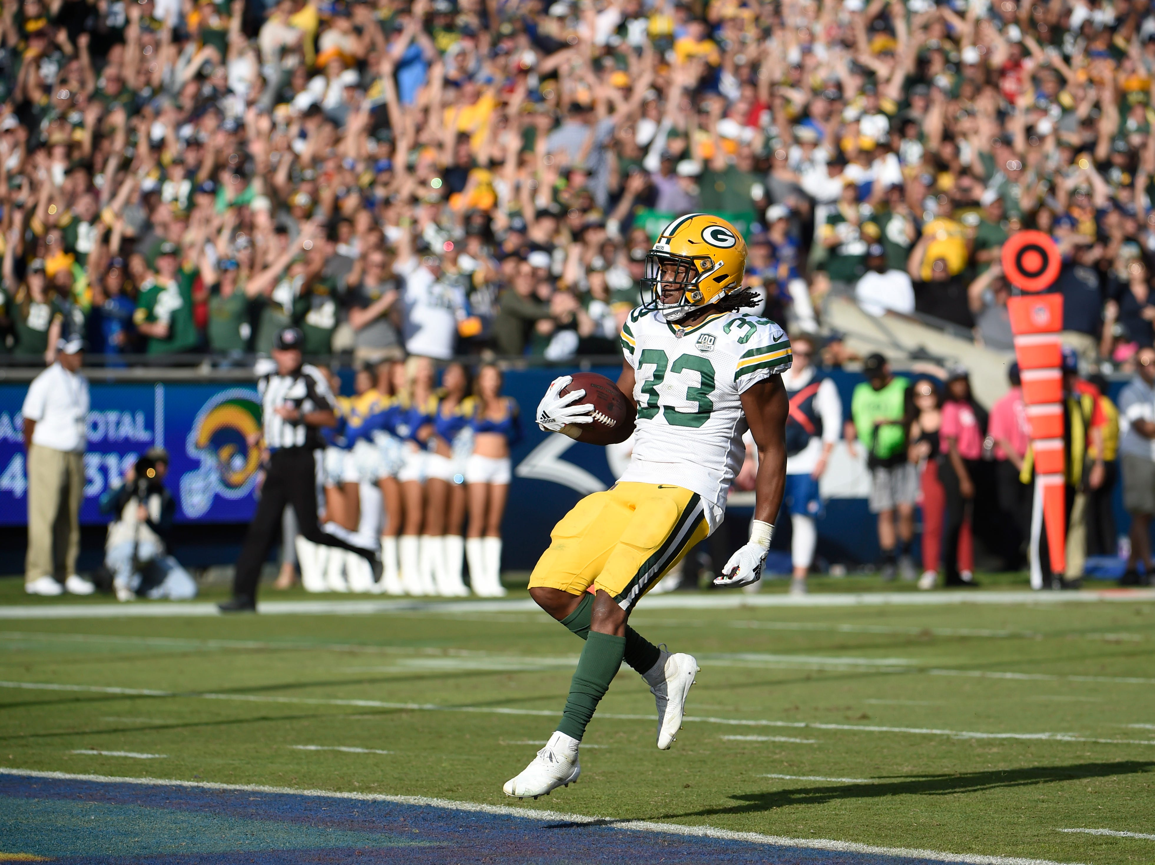 Green Bay Packers running back Aaron Jones scores a touchdown during the second half of an NFL football game against the Los Angeles Rams, Sunday, Oct. 28, 2018, in Los Angeles. (AP Photo/Denis Poroy)