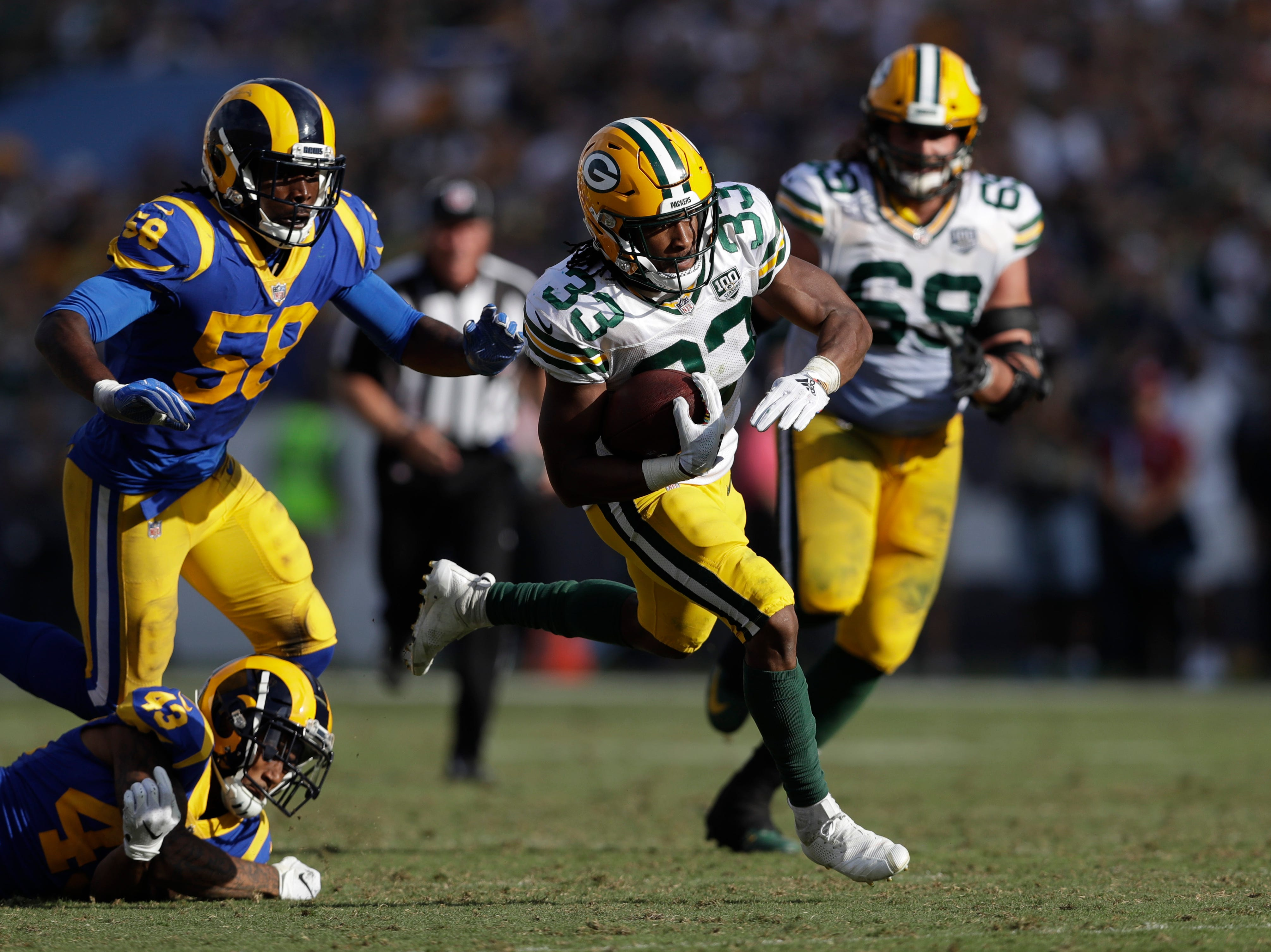 Green Bay Packers running back Aaron Jones gets past Los Angeles Rams strong safety John Johnson (43) on his way to scoring a touchdown during the second half of an NFL football game, Sunday, Oct. 28, 2018, in Los Angeles. (AP Photo/Marcio Jose Sanchez)