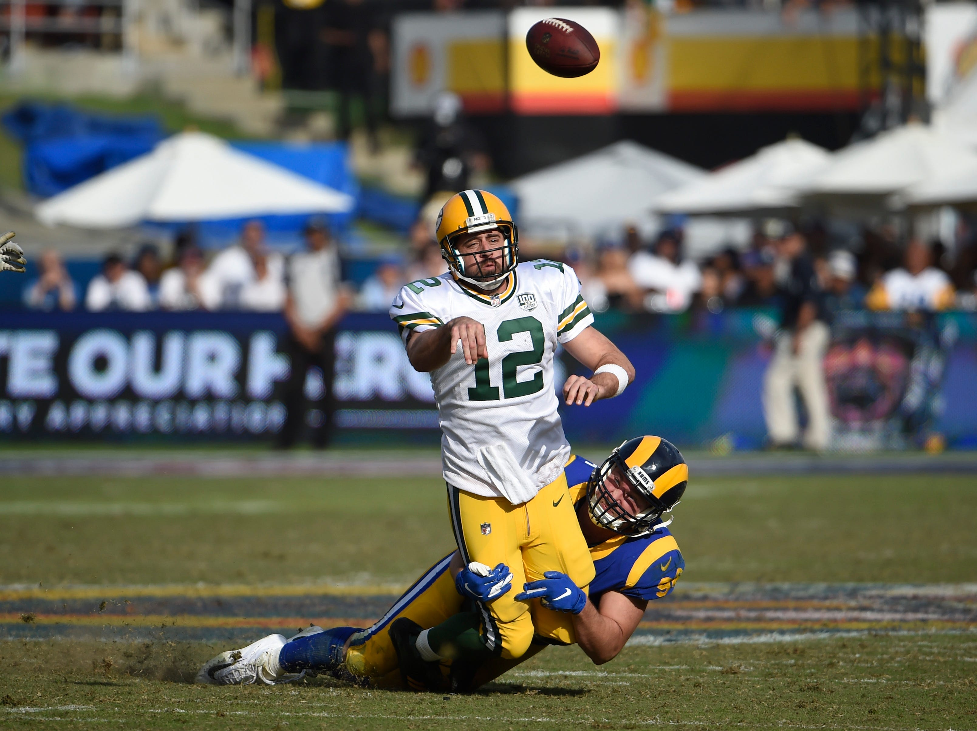 Green Bay Packers quarterback Aaron Rodgers is hauled down by Los Angeles Rams defensive tackle Ethan Westbrooks during the second half of an NFL football game, Sunday, Oct. 28, 2018, in Los Angeles. (AP Photo/Denis Poroy)