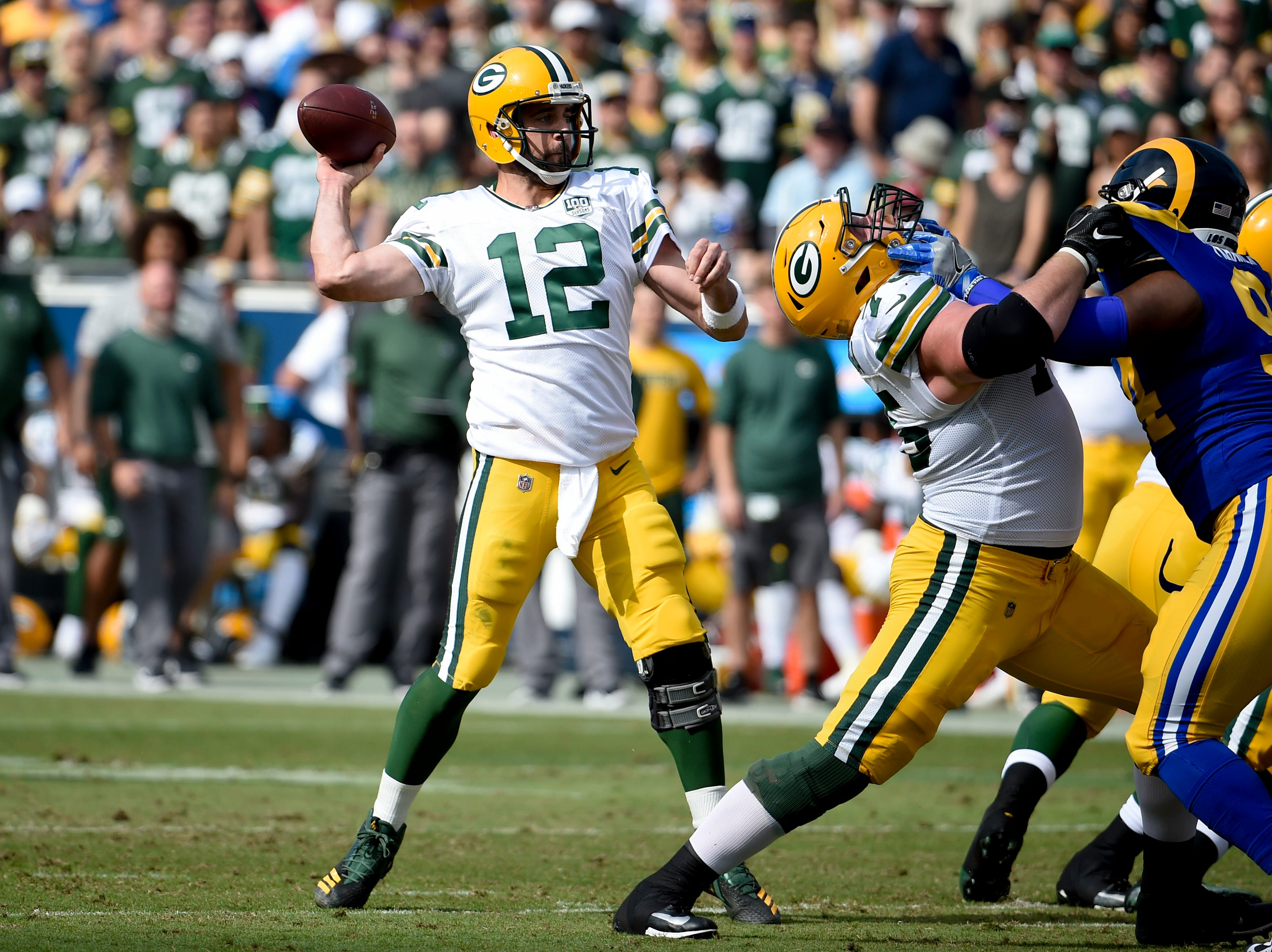 Green Bay Packers quarterback Aaron Rodgers throws a pass during the first half of an NFL football game against the Los Angeles Rams, Sunday, Oct. 28, 2018, in Los Angeles. (AP Photo/Denis Poroy)