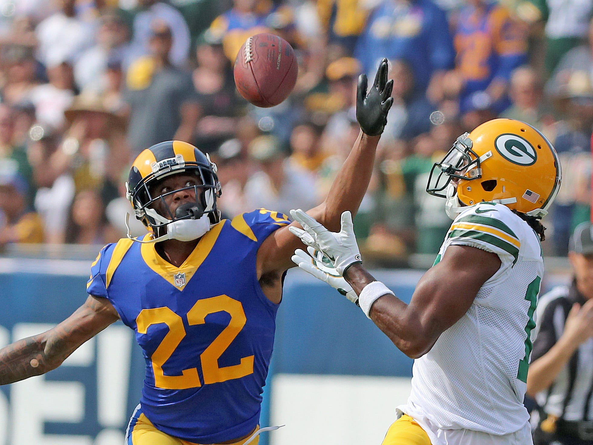 Green Bay Packers wide receiver Davante Adams (17) catcher a long pass against the LA Rams cornerback Marcus Peters (22) Sunday, October 28, 2018 at the Memorial Coliseum in Los Angeles.
