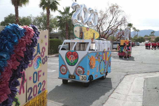 Floats from Palm Desert High School wait in the staging area ahead of the Palm Desert Golf Cart Parade, Palm Desert, Calif., Sunday, October 28, 2018.