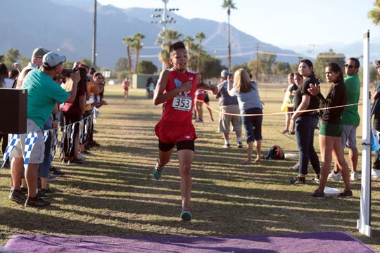 Indio's Victor Urbina wins the boys Desert Valley League cross county race on Saturday, October 27, 2018 in Palm Springs.