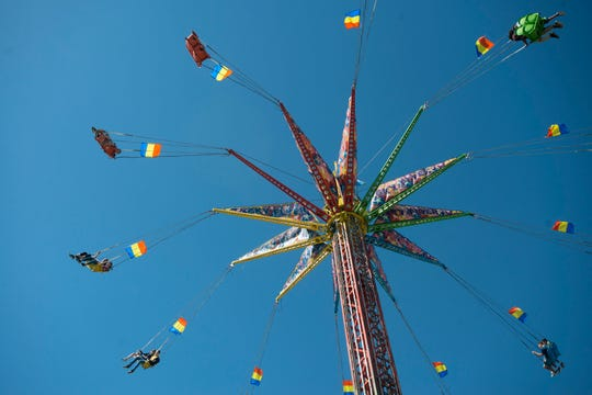 Visitors enjoy the final day of the Pensacola Interstate Fair in 2018. Fairfield Drive got its name from the fairgrounds property initially used by the Pensacola Interstate Fair before they relocated to their current site.